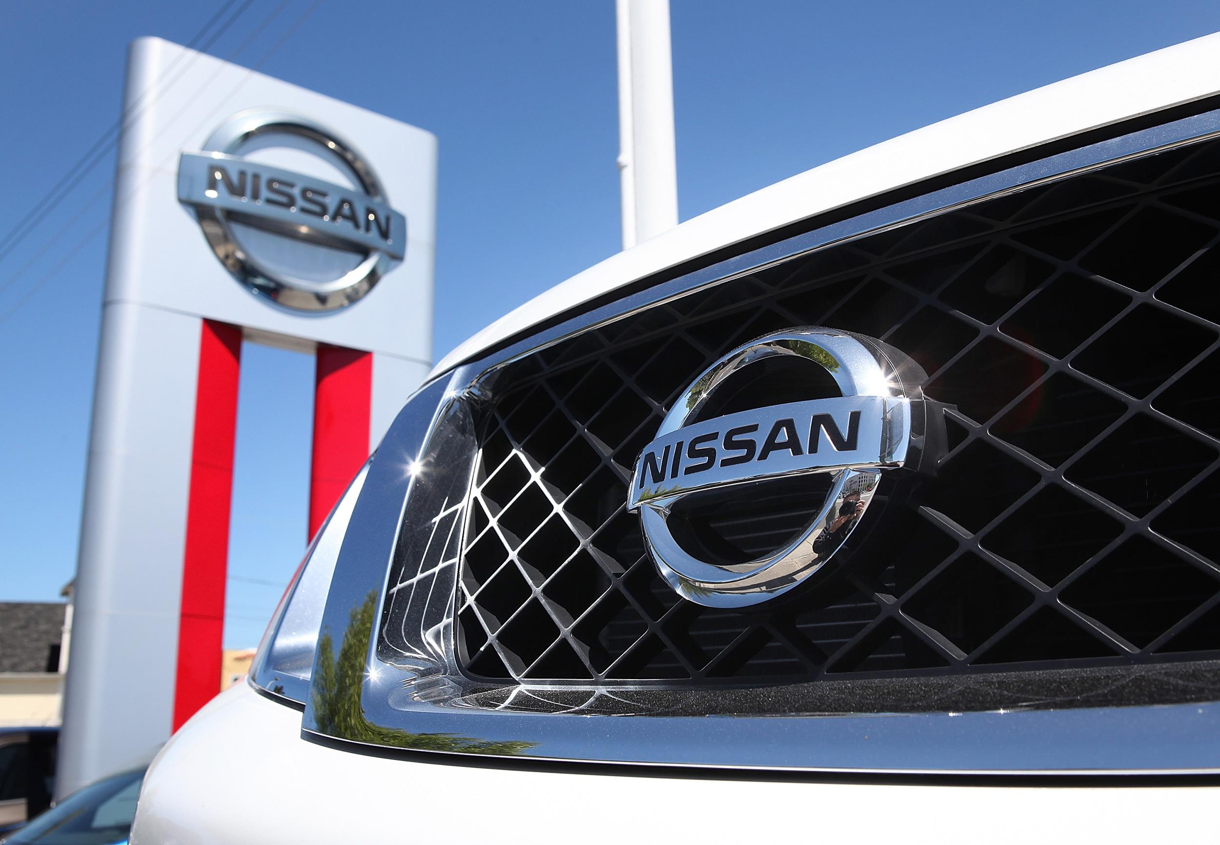 Image: The Nissan logo is seen on the front of a brand new Nissan SUV at a Nissan dealership in Millbrae, Calif.