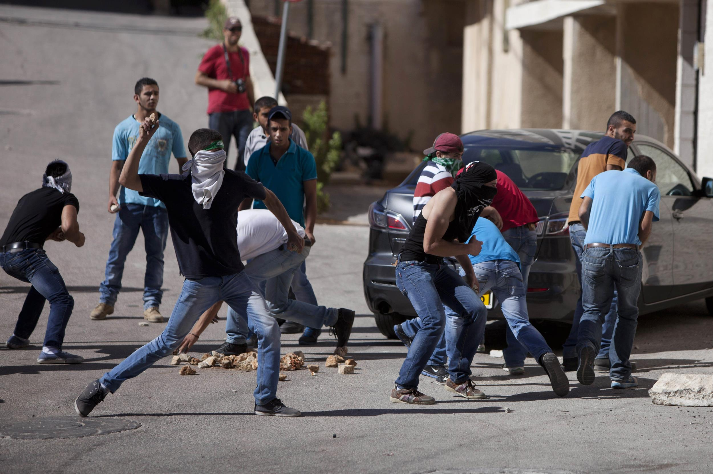 Image: Palestinian protesters hurl stones at Israeli soldiers