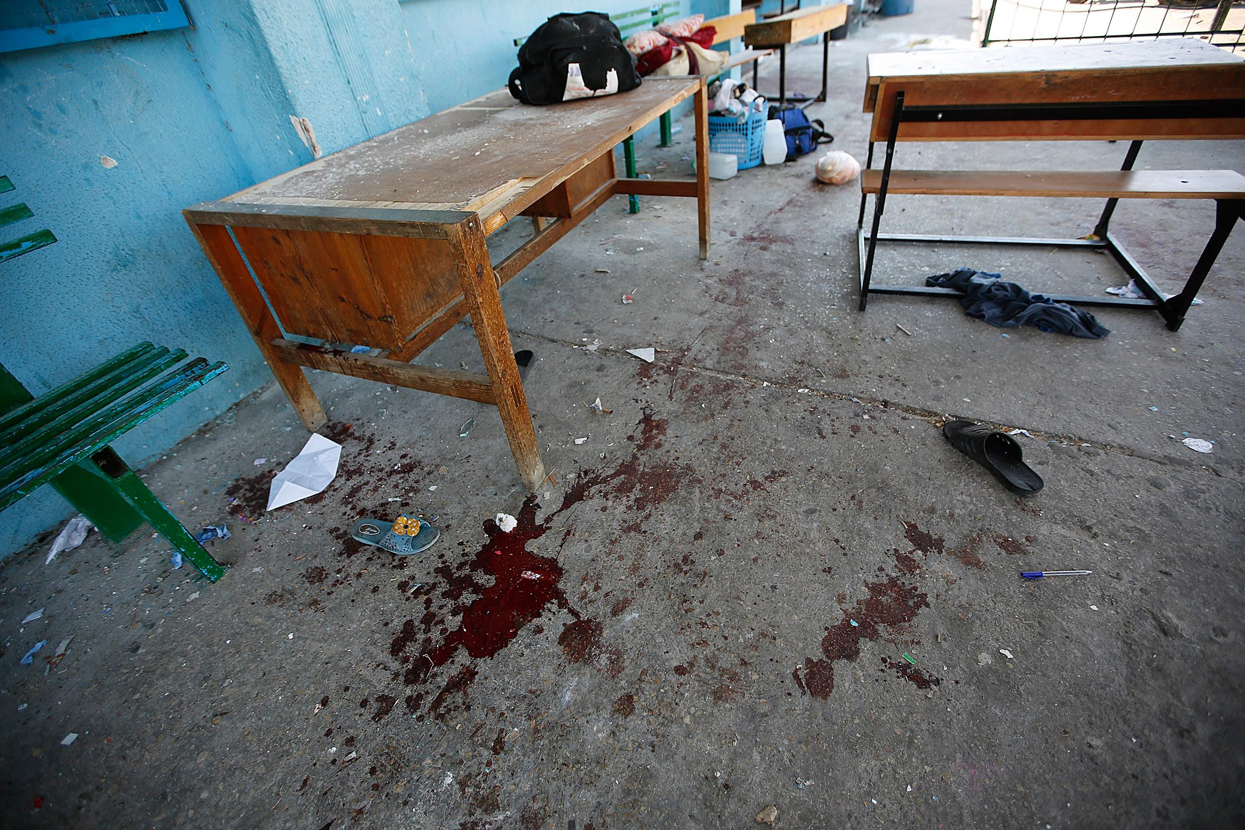 Image: Blood is seen among school desks in a UN-operated school after an Israeli attack in Beit Hanun town, northern Gaza strip, on July 24.