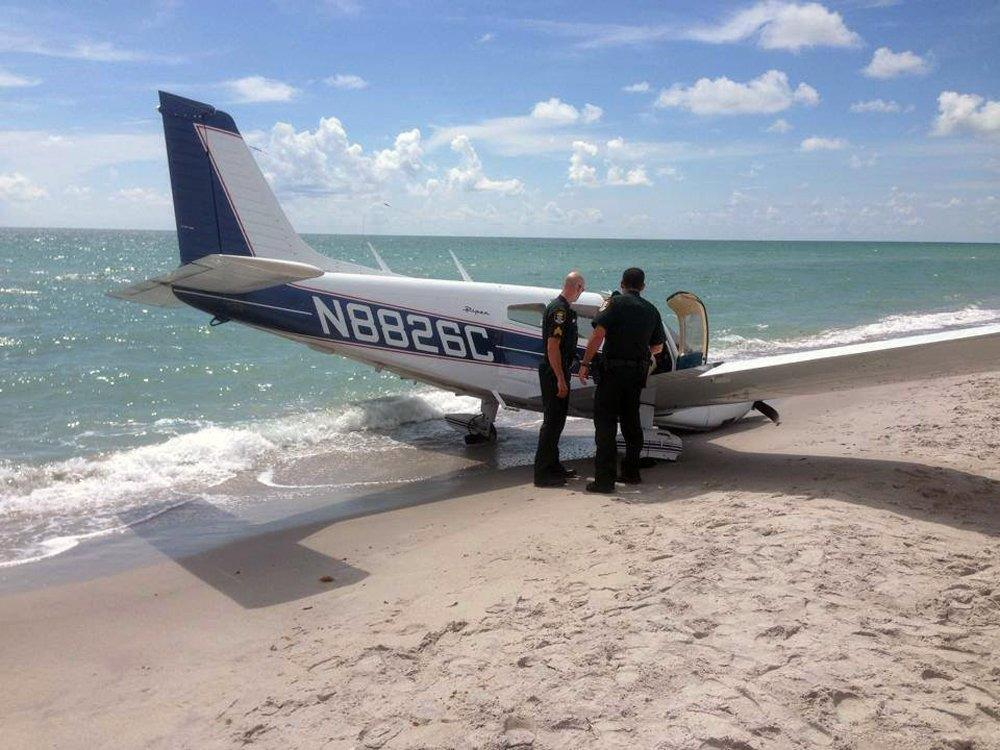 Image: Emergency personnel work at the scene of a small plane crash in Caspersen Beach in Venice, Fla.