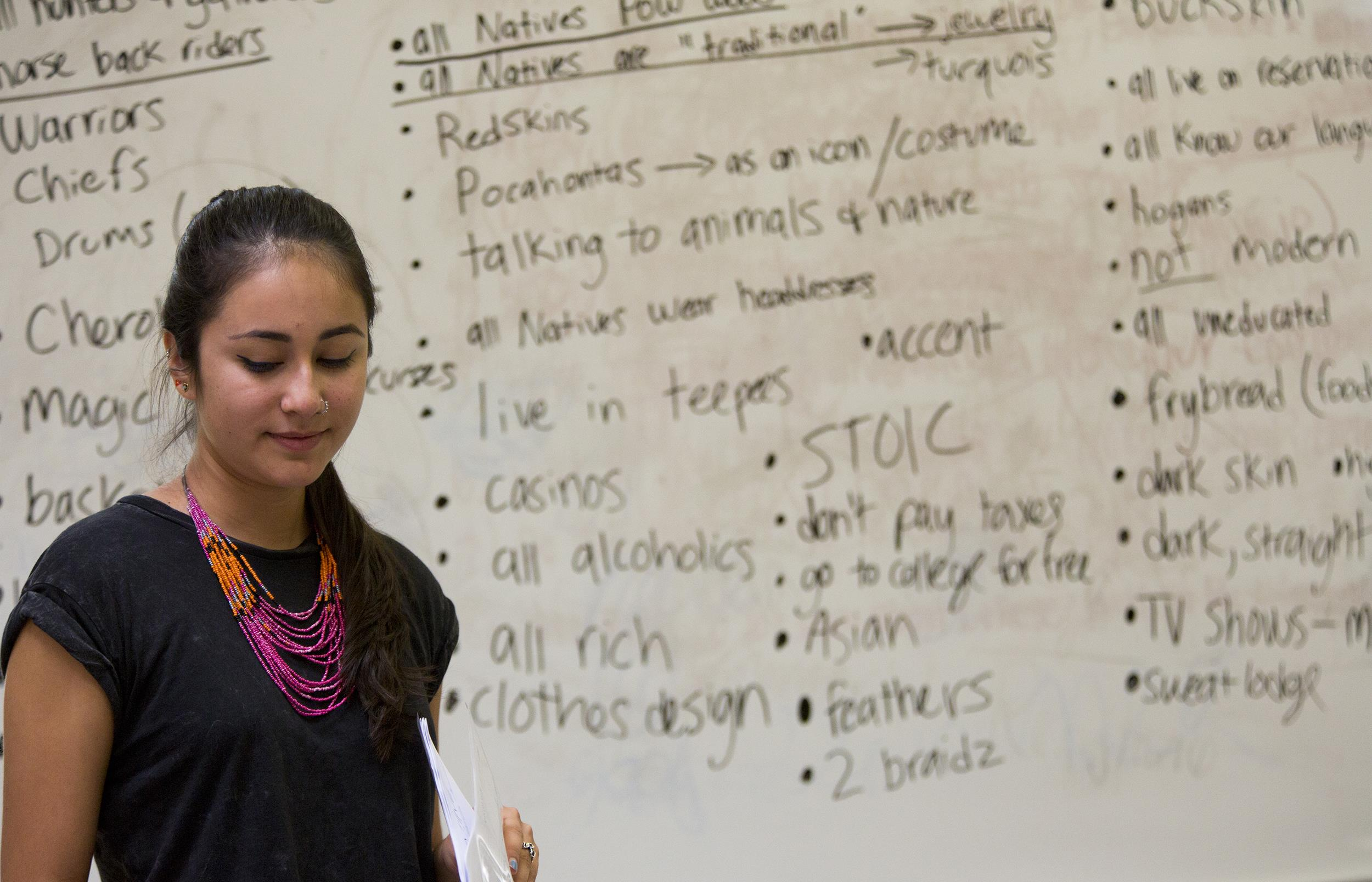 Image: Braudie Blais-Billie, 21, a Columbia University student and a member of the Seminole tribe in Florida, leads a discussion with a group of high school and younger students on the Tohajiilee reservation about Native stereotypes.