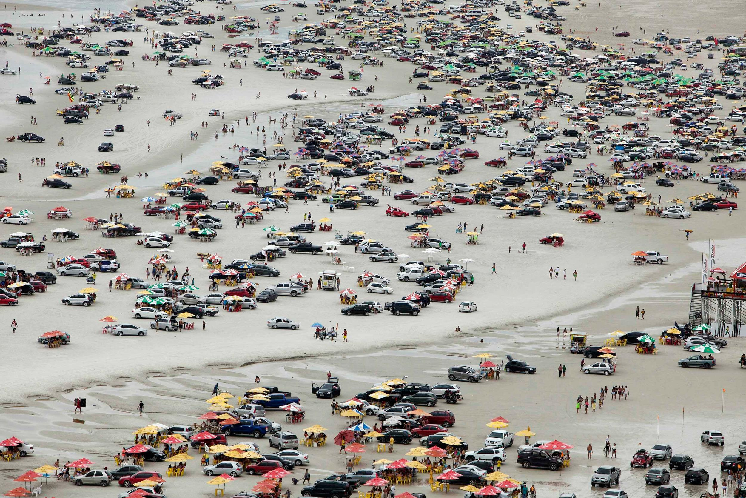Image: A view of thousands of beachgoers during the peak of the summer vacation season on Atalaia beach in Salinopolis