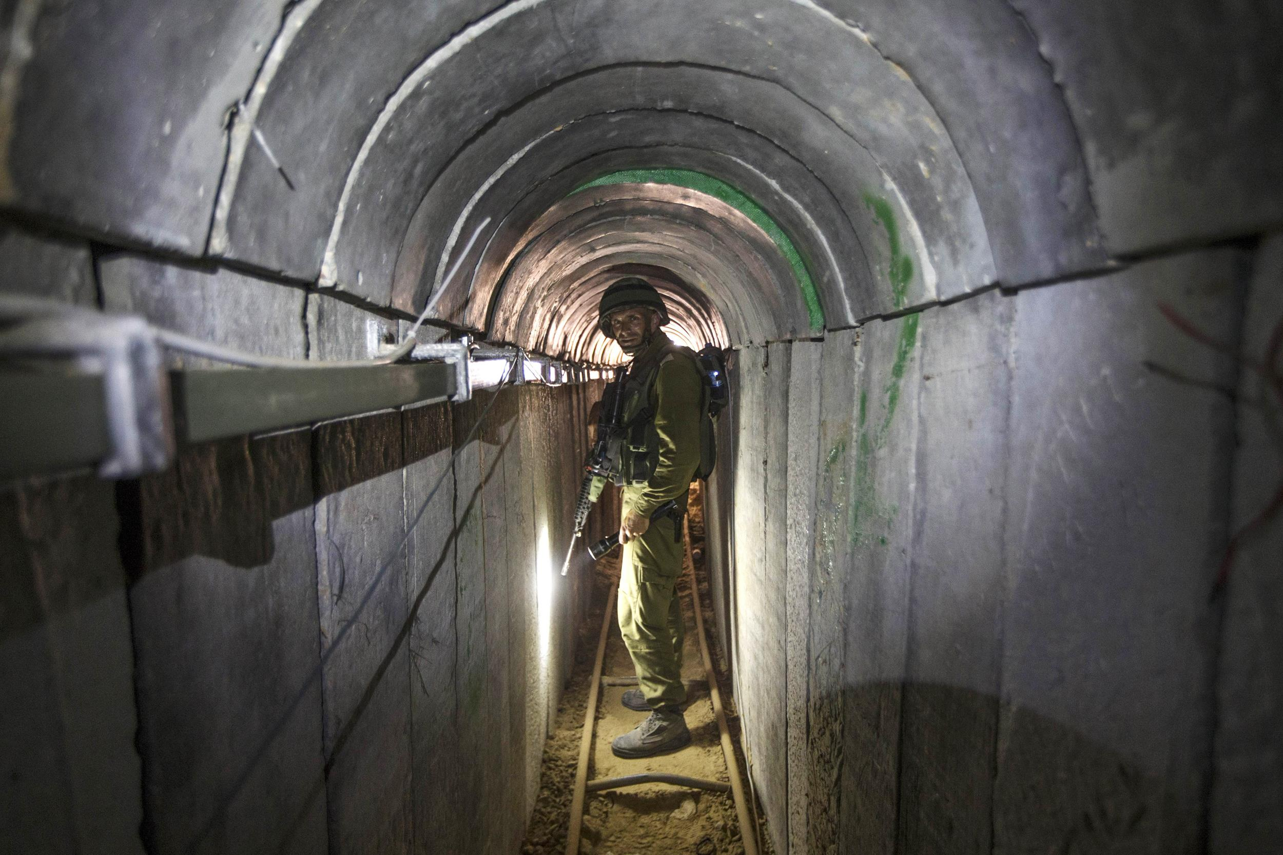Image: An Israeli army officer gives journalists a tour