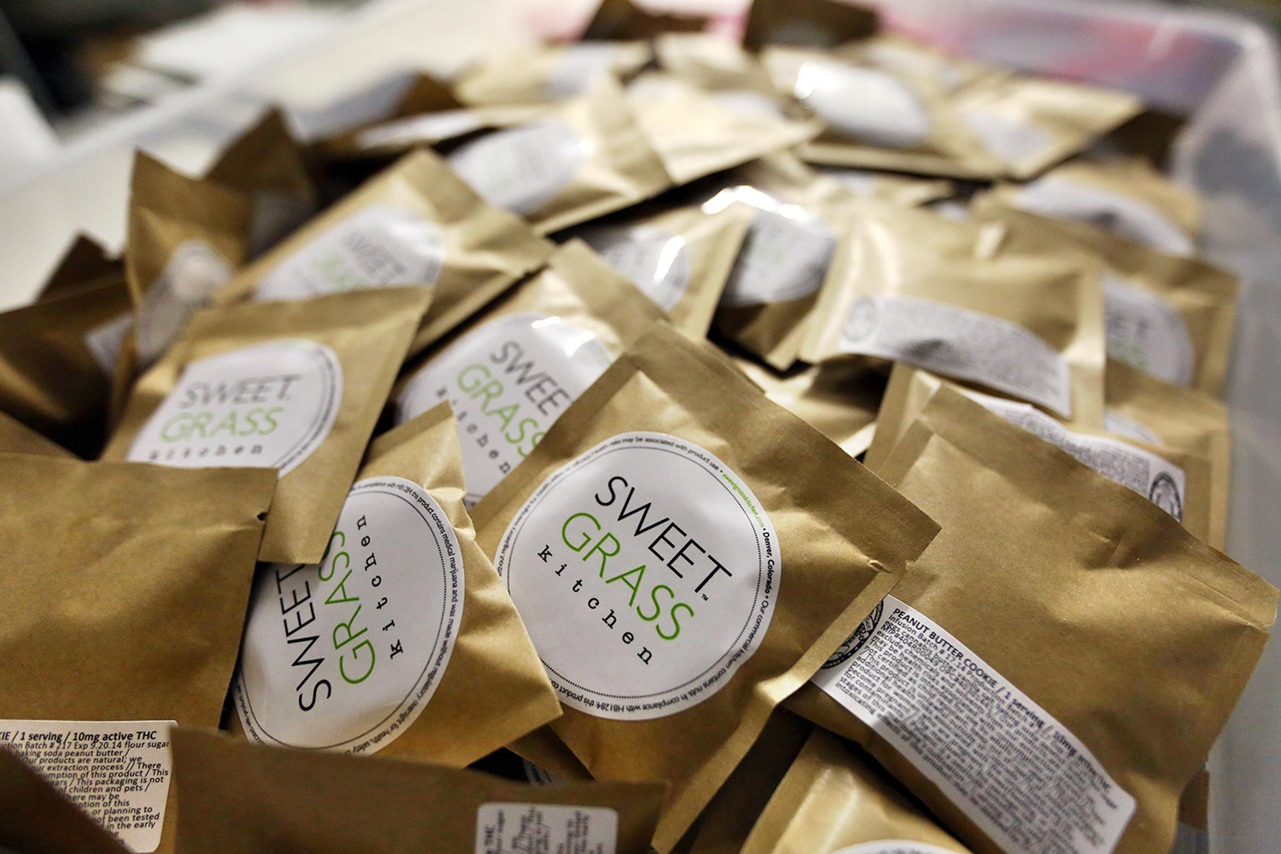 Image: Freshly packaged cannabis-infused peanut butter cookies are prepared for casing