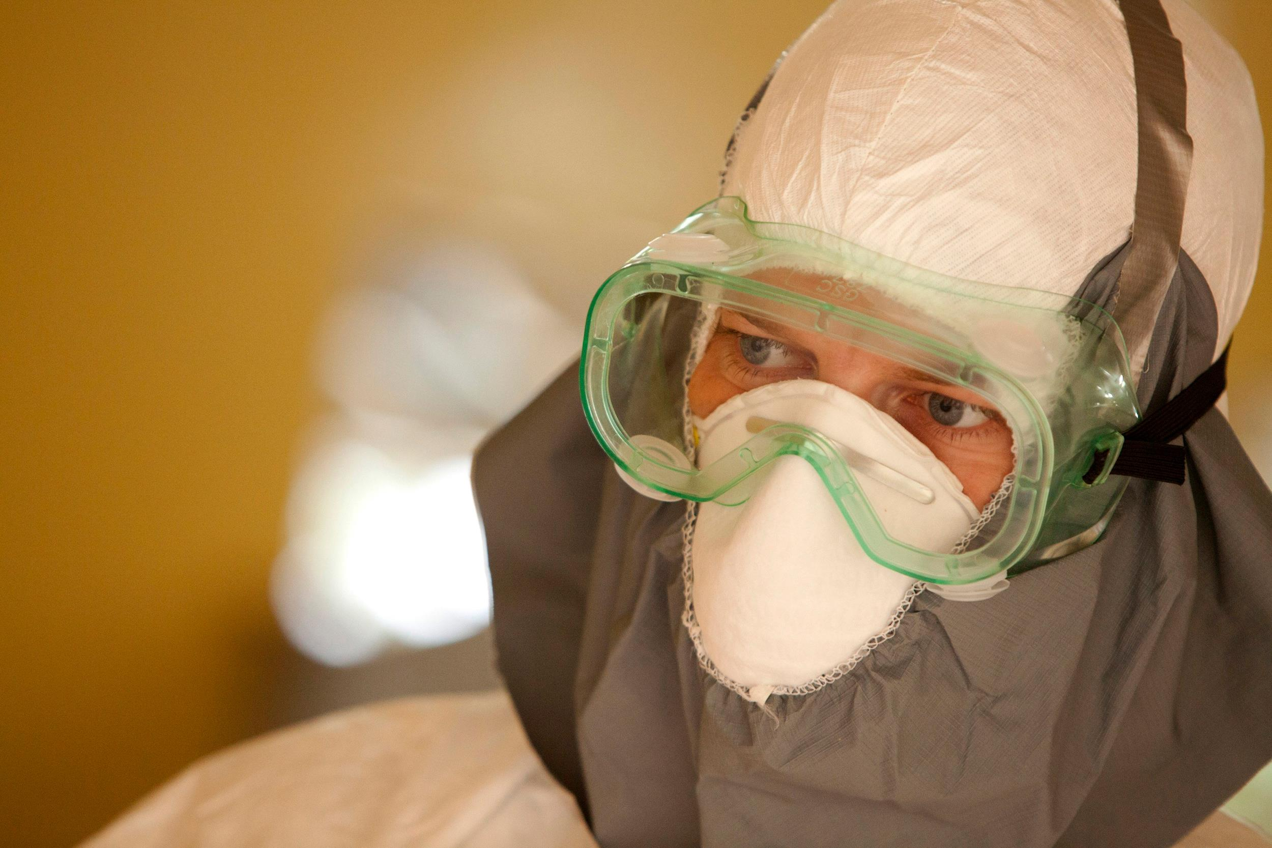 Image: Dr. Kent Brantly wearing protective gear at the case management center on the campus of ELWA Hospital in Monrovia
