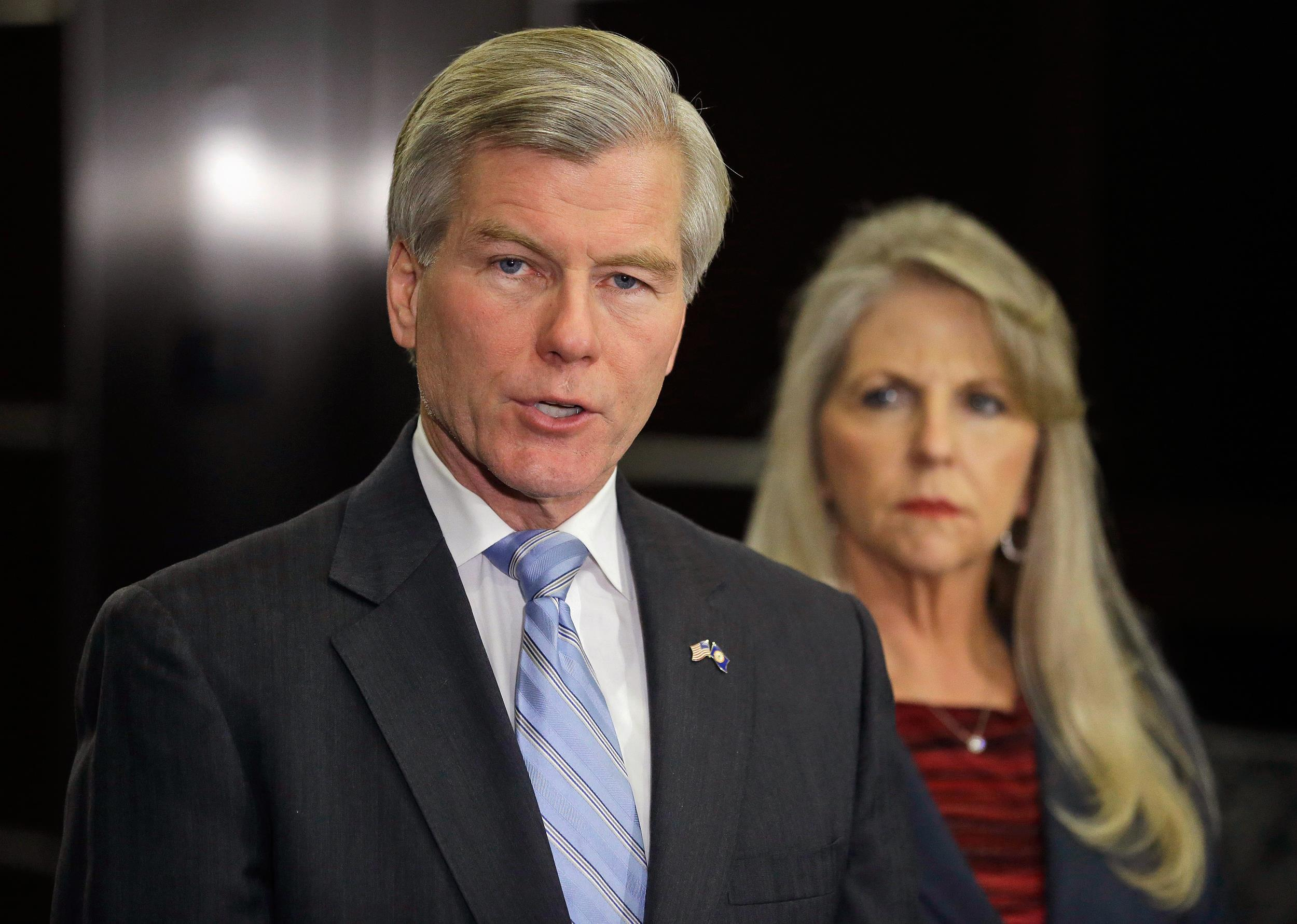 Image: Former Virginia Gov. Bob McDonnell makes a statement with his wife, Maureen, in January.