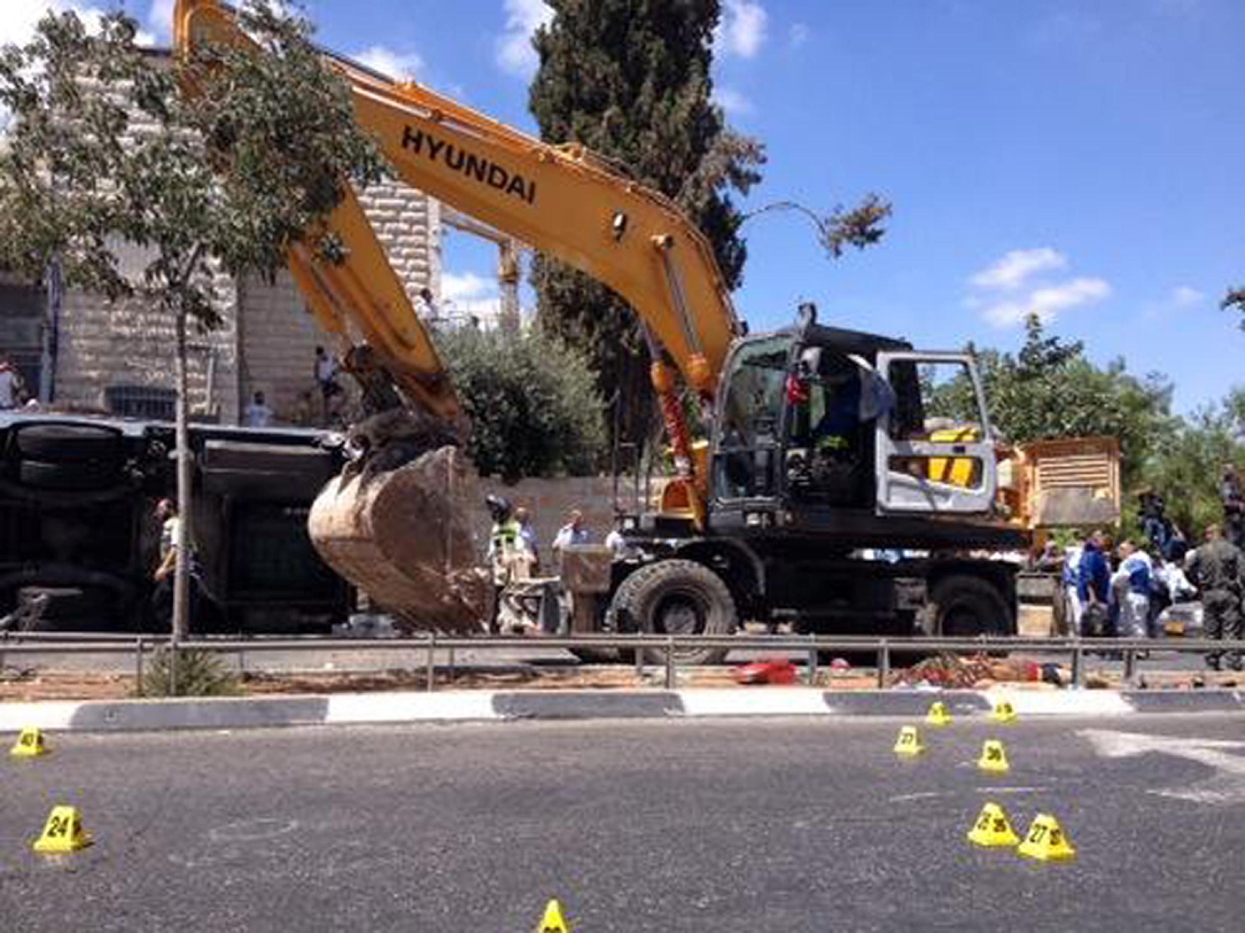 A tractor at the scene of what police described as a terrorist attack in Jerusalem on August 4, 2014.