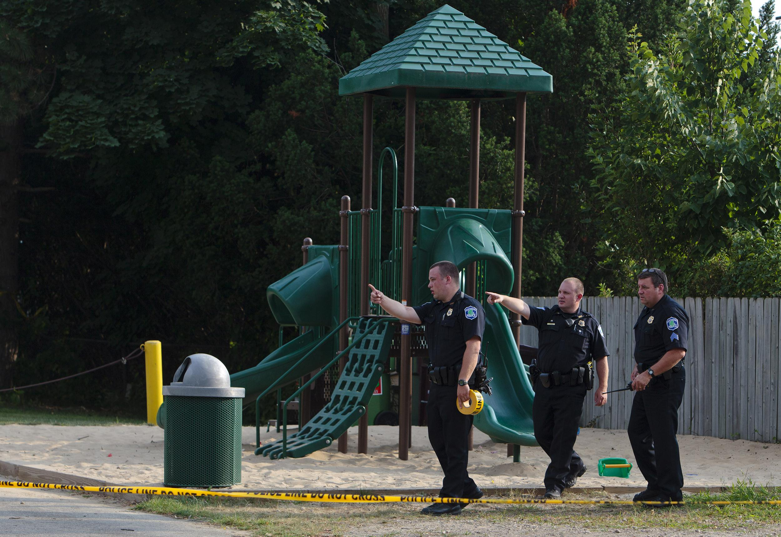 Image: Kentwood police investigate a stabbing that occurred in a playground in Pinebrook Village, in Kentwood, Mich., on Aug. 4