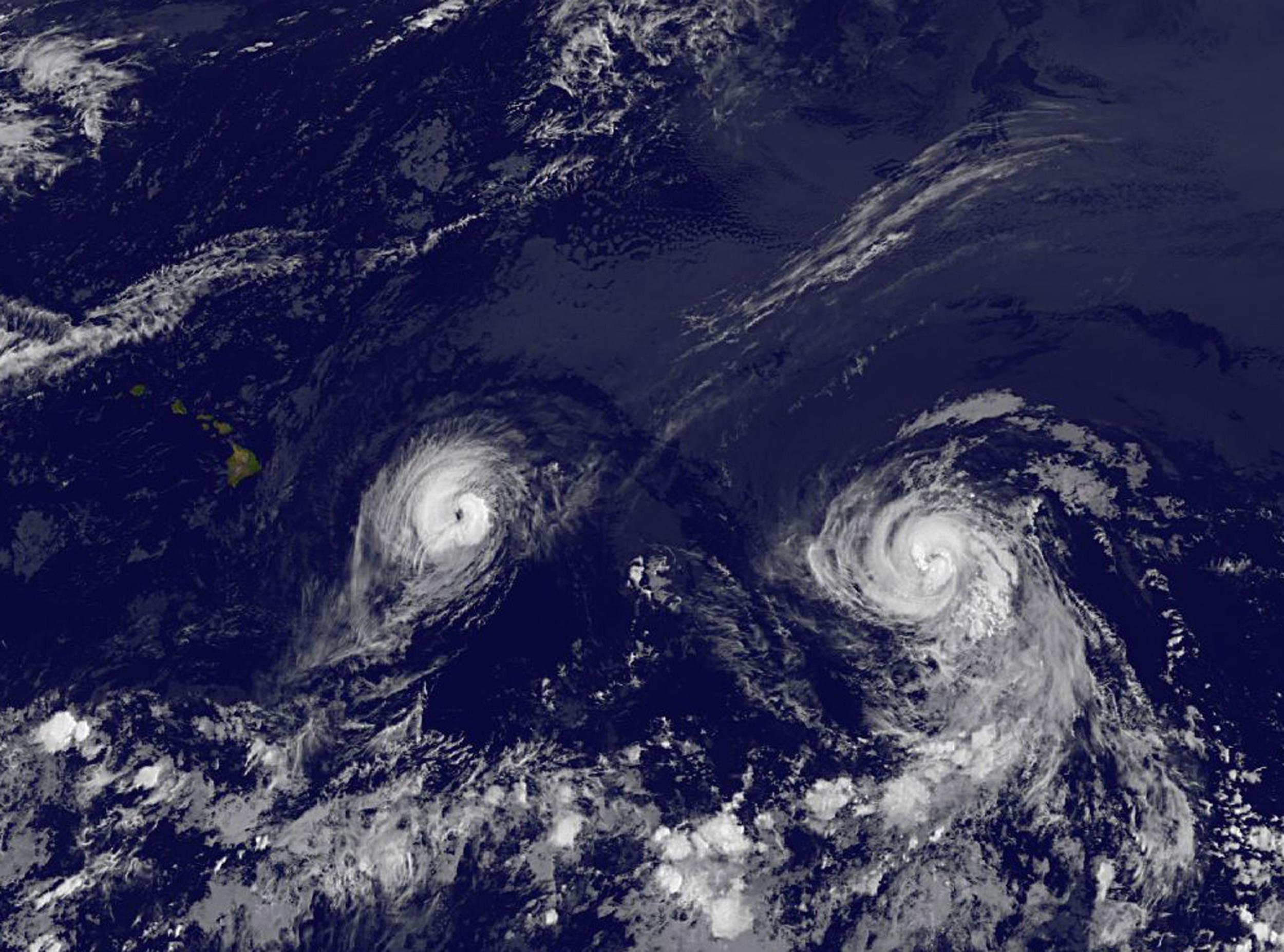 Image: A satellite image taken Thursday Aug. 7, 2014 at 2 a.m. EDT shows Hurricane Iselle, left and Hurricane Julio.