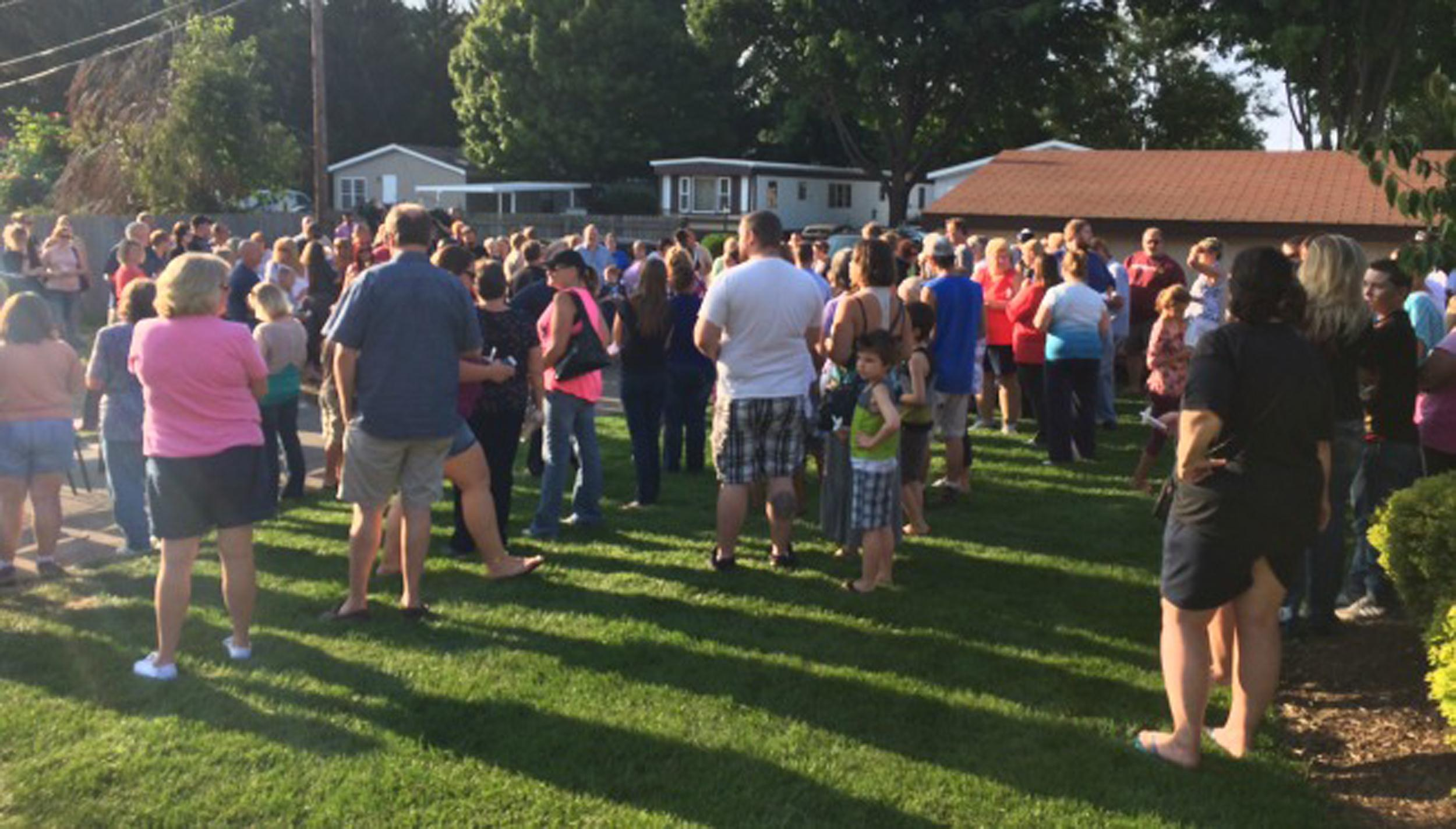 Image: Several hundred people gathered for a candlelight vigil Wednesday night at the park where 9-year-old Michael