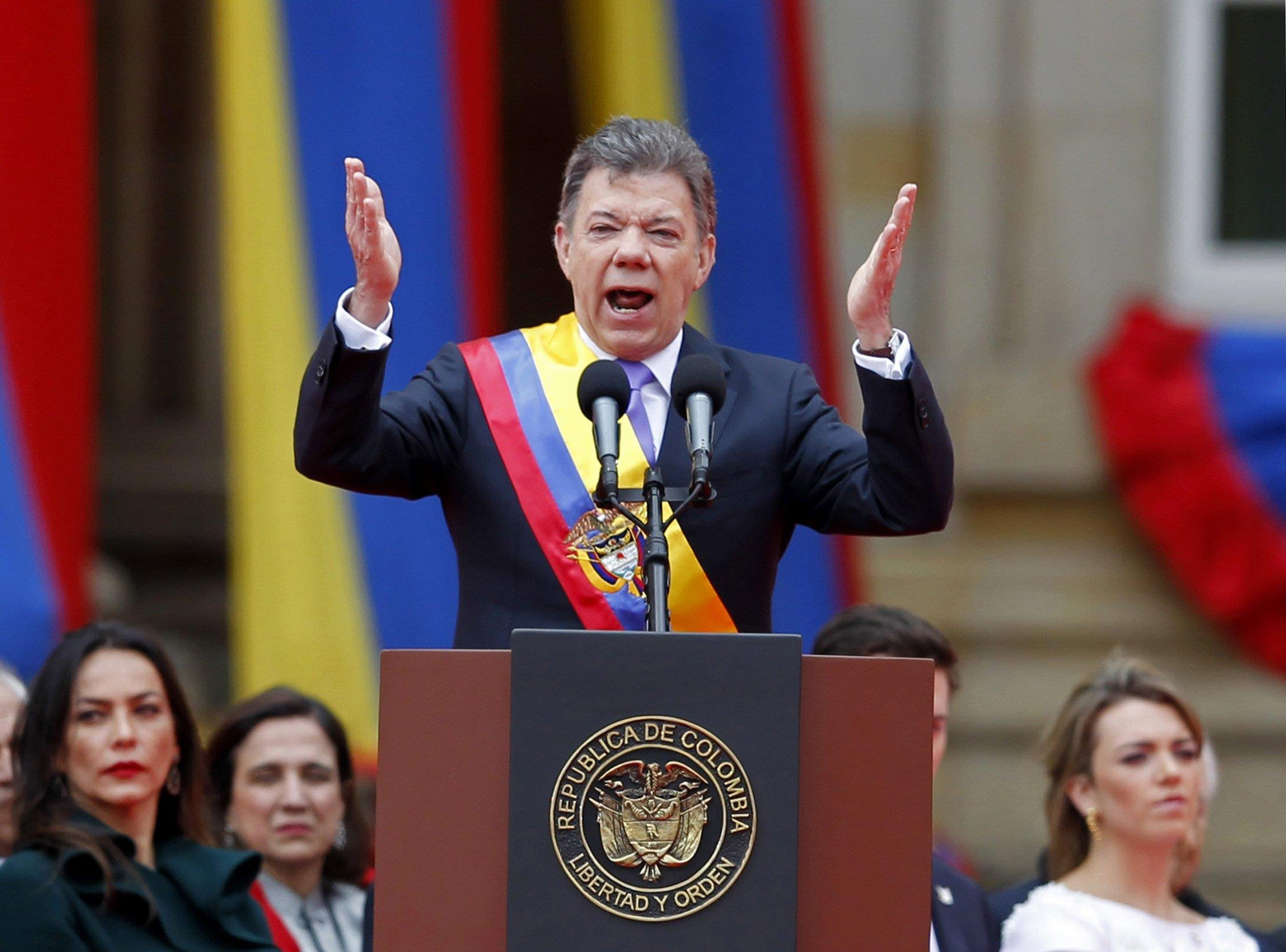 Image: Colombia's President Santos gestures during a speech at an inaguration ceremony to commemorate his second term in Bogota
