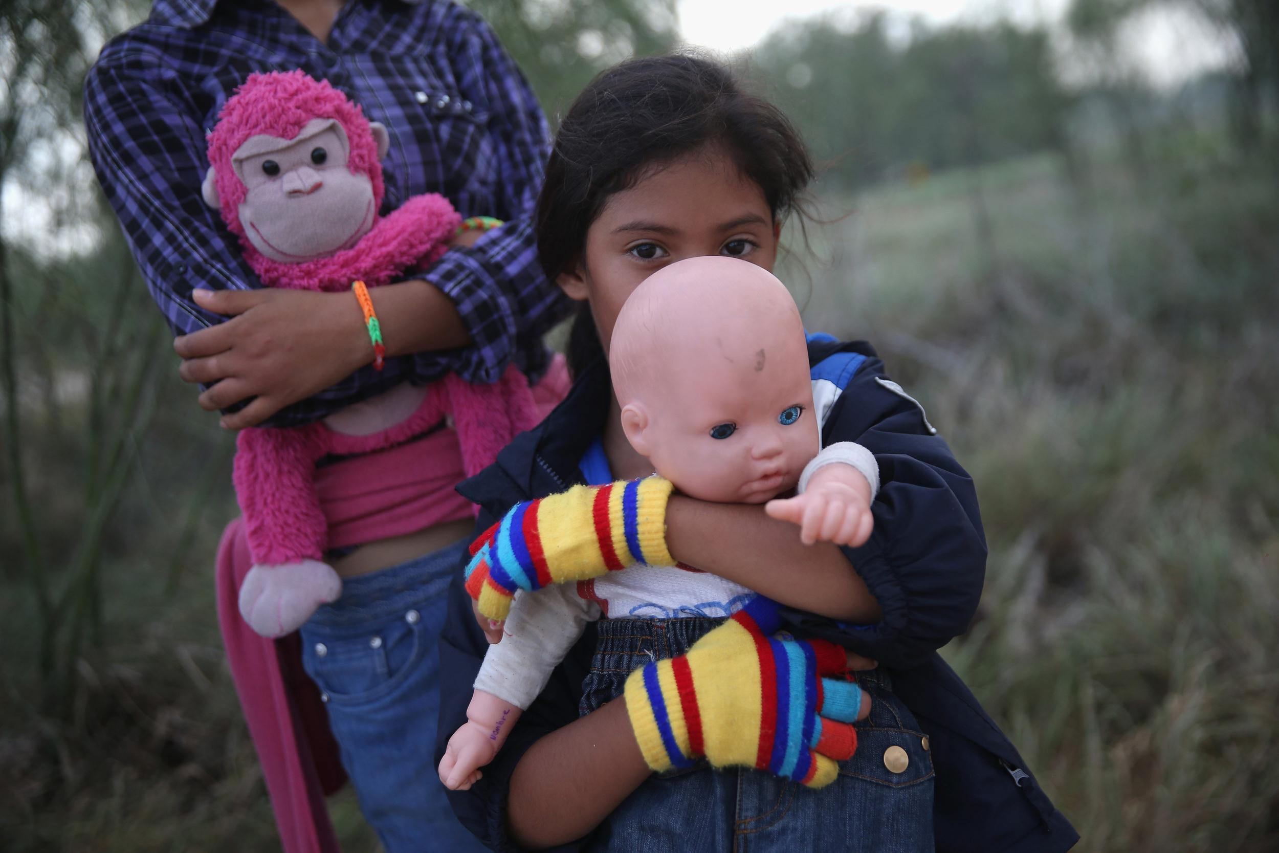 Image: Salvadorian immigrant Stefany Marjorie, 8, holds her doll Rodrigo after crossing the Rio Grande from Mexico into the United States