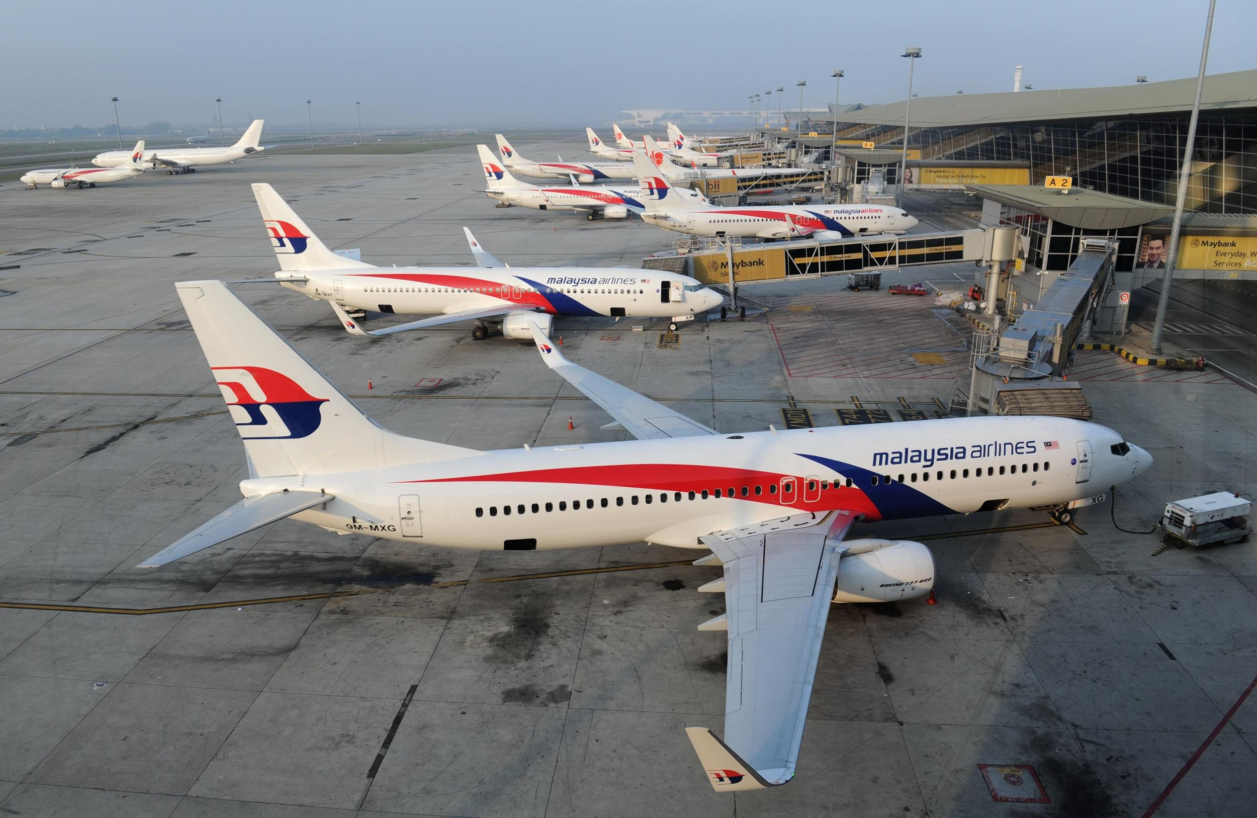 Image: Malaysia Airlines planes parked at the terminal at Kuala Lumpur Intenational Airport (KLIA) in Sepang, on March 30.