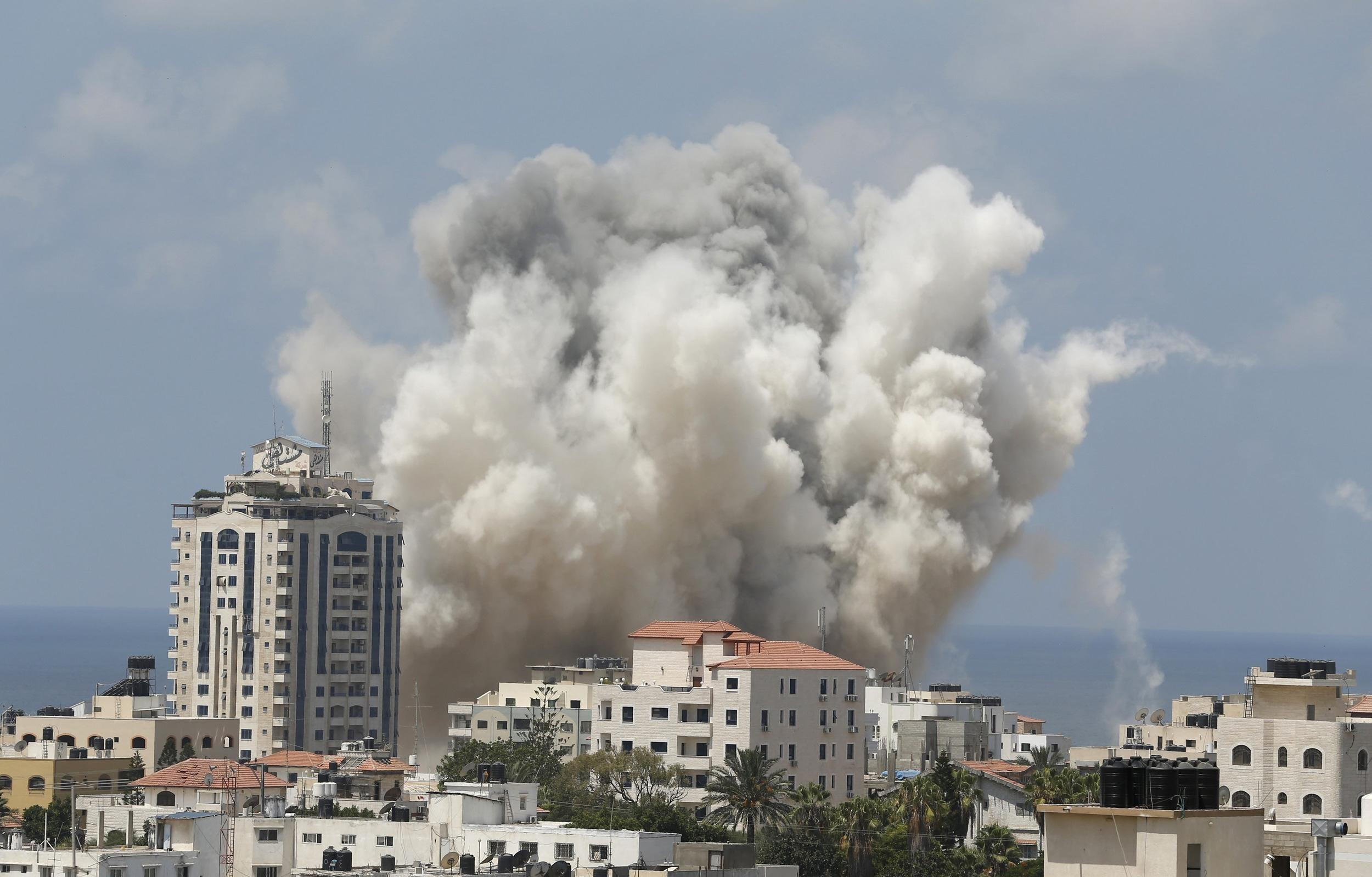 Image: Smoke rises following what witnesses said was an Israeli air strike in Gaza City