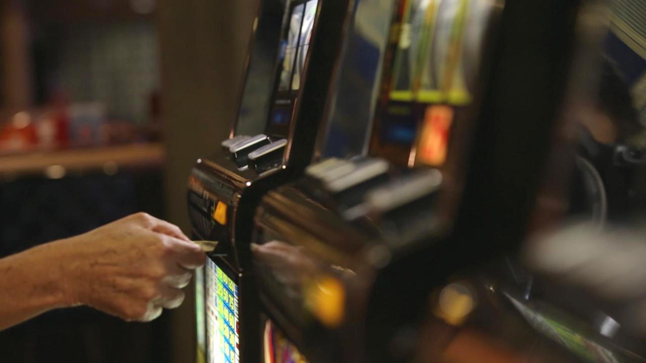 Image: A person gambles at a casino