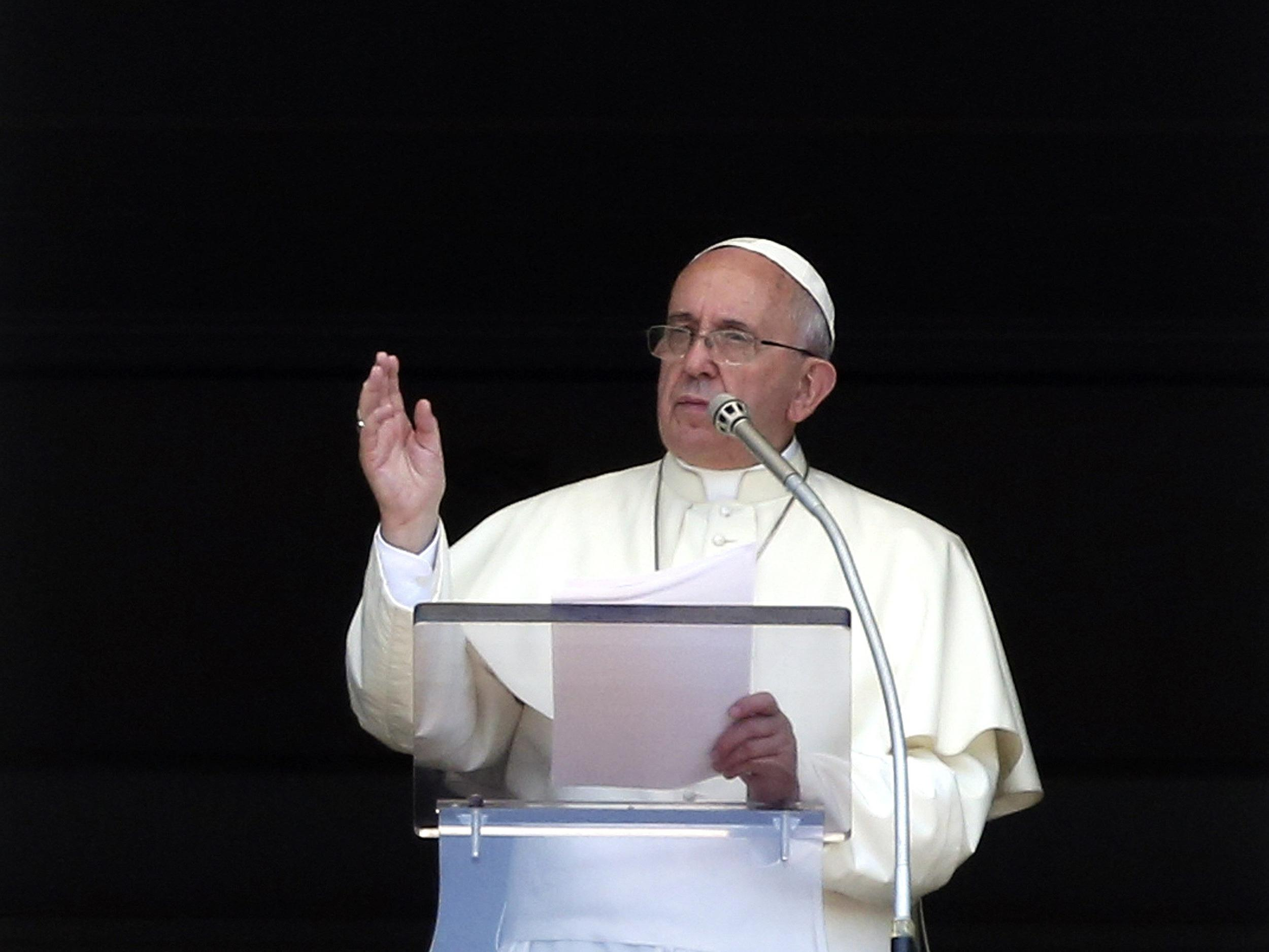 Image: Pope Francis speaks as he leads the Angelus prayer in Saint Peter's Square at the Vatican