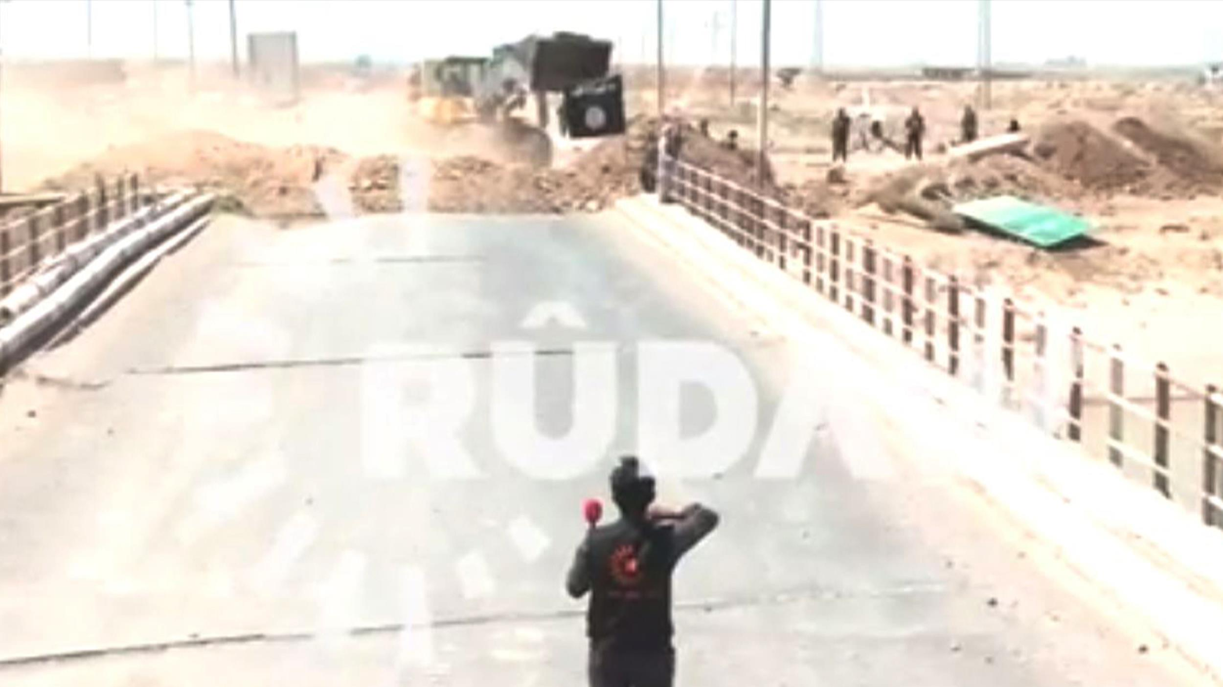 Image: Rudaw reporter Halo Ahmed walks on a bridge as he attempts to speak with ISIS.