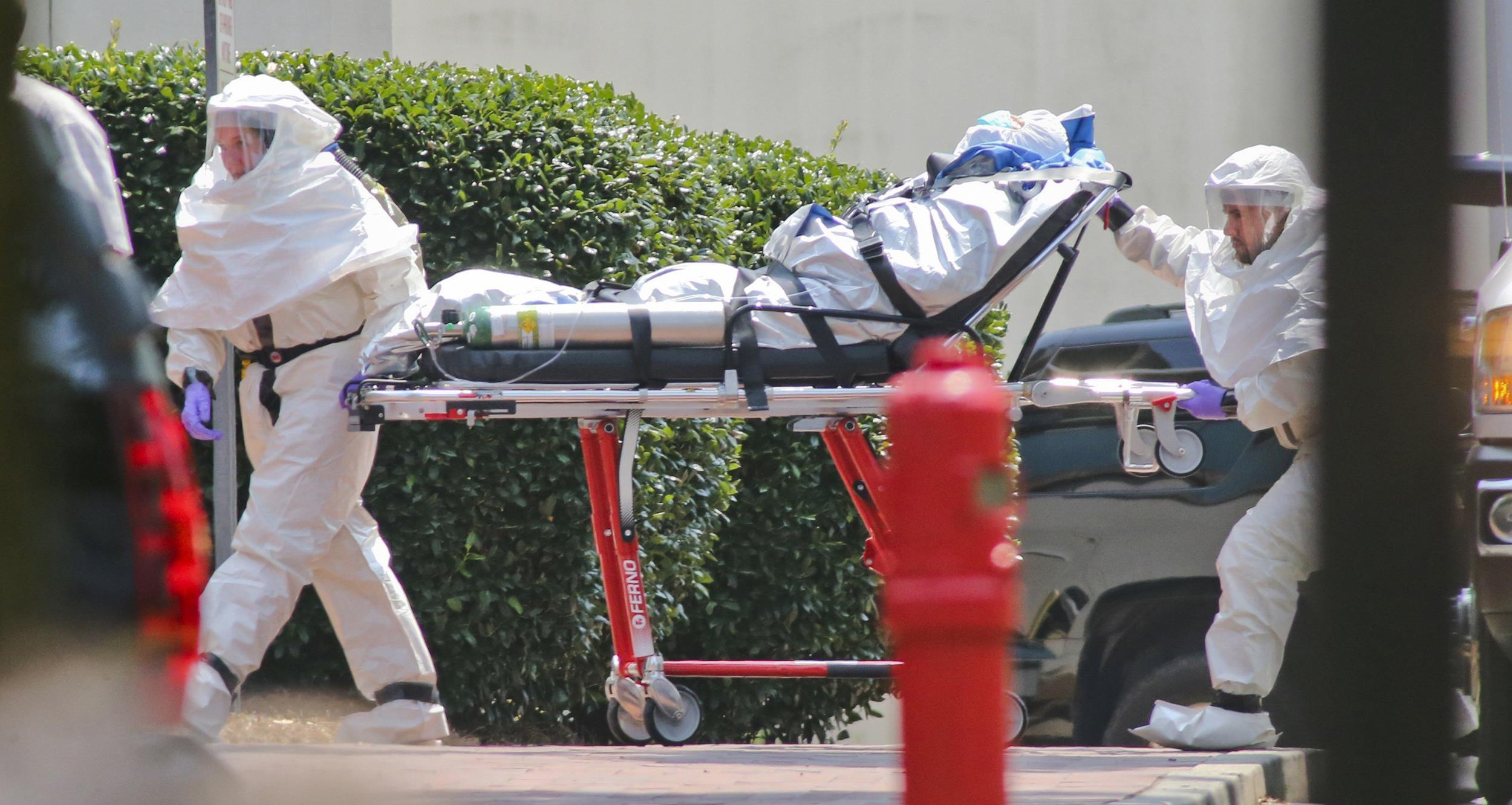 Image: Medical workers roll patient Nancy Writebol into Emory University Hospital in Atlanta on Aug. 5.