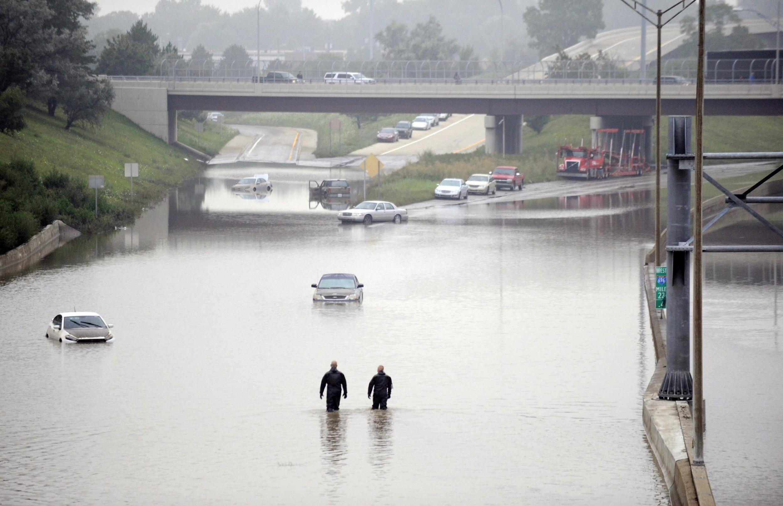 Image: Cars are stranded along a flooded stretch of I-696 at the Warren, Mich. city limits