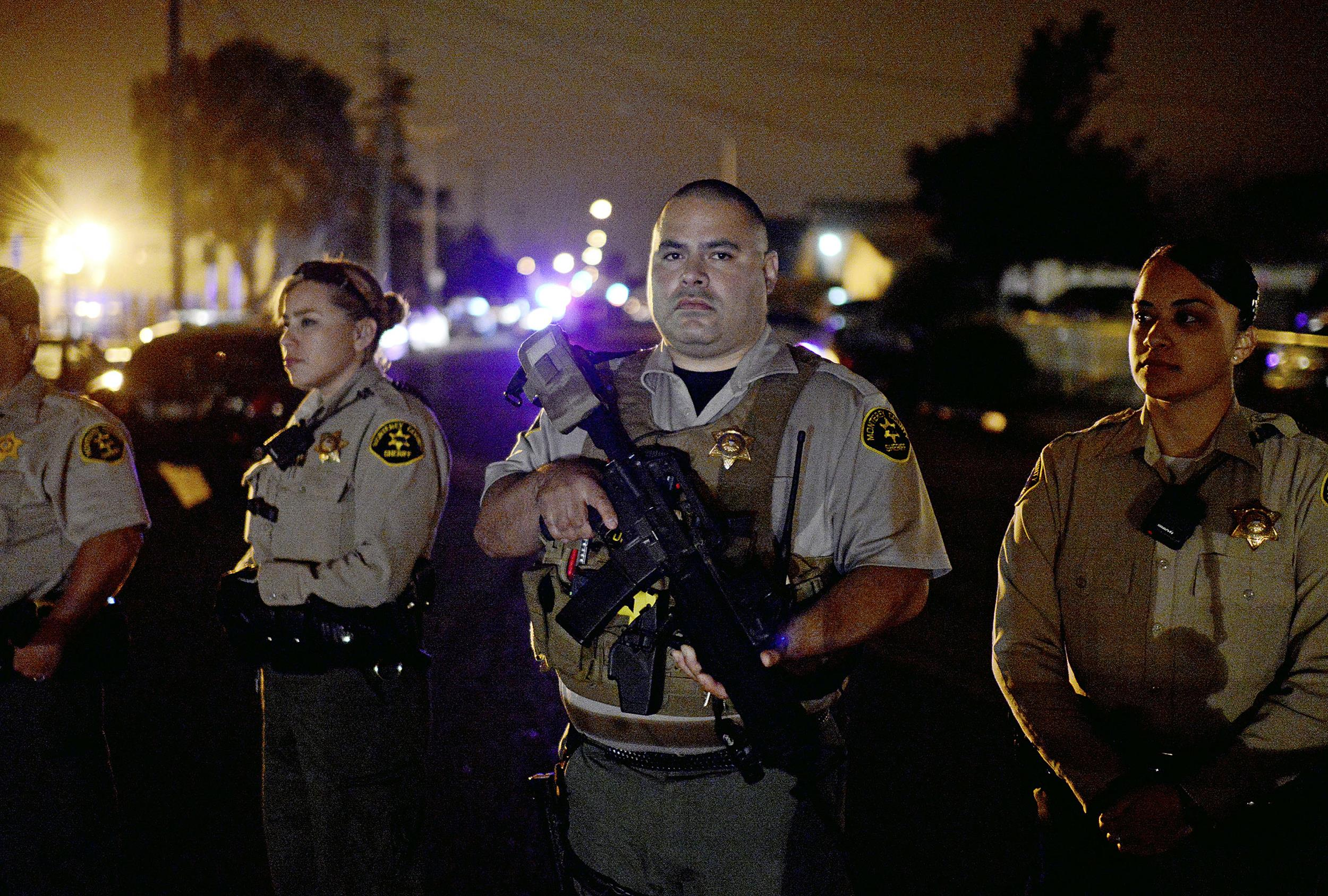Image: Law enforcement officers hold a perimeter on Del Monte Avenue in Salinas, Calif., on May 21