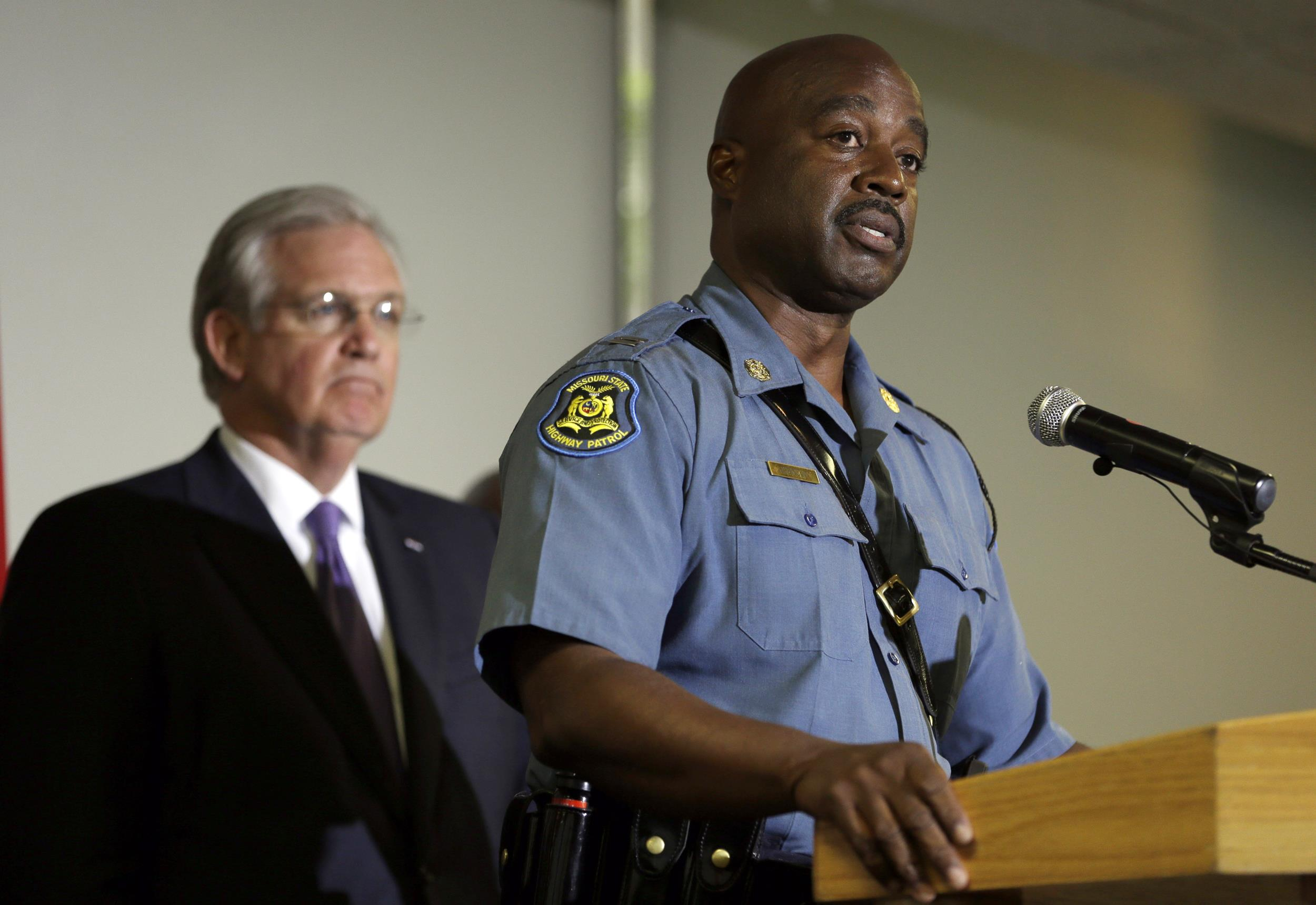 Image: Capt. Ron Johnson of the Missouri Highway Patrol speaks during a news conference