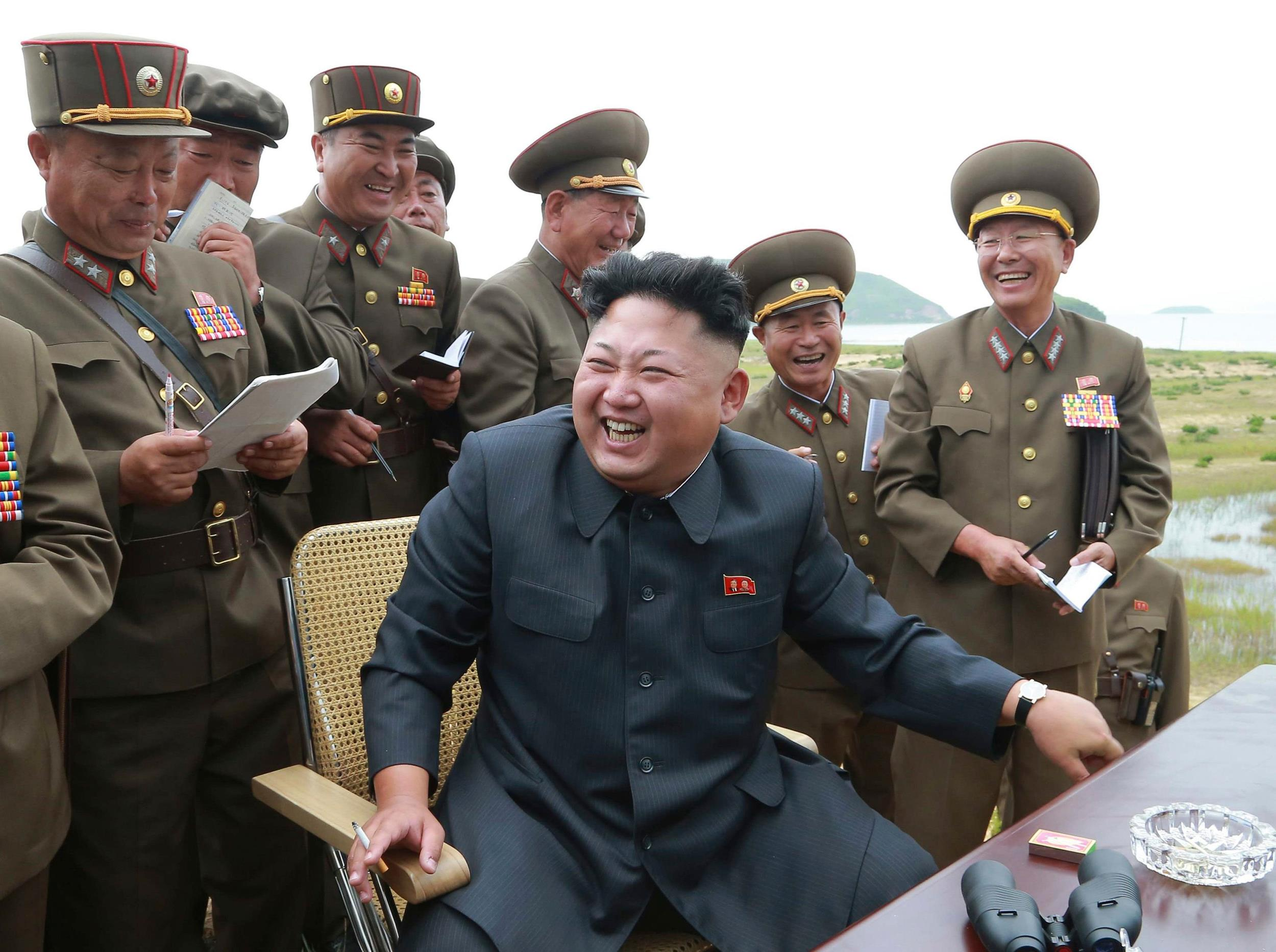 Image: North Korean leader Kim Jong Un guides the test fire of a tactical rocket in this undated photo
