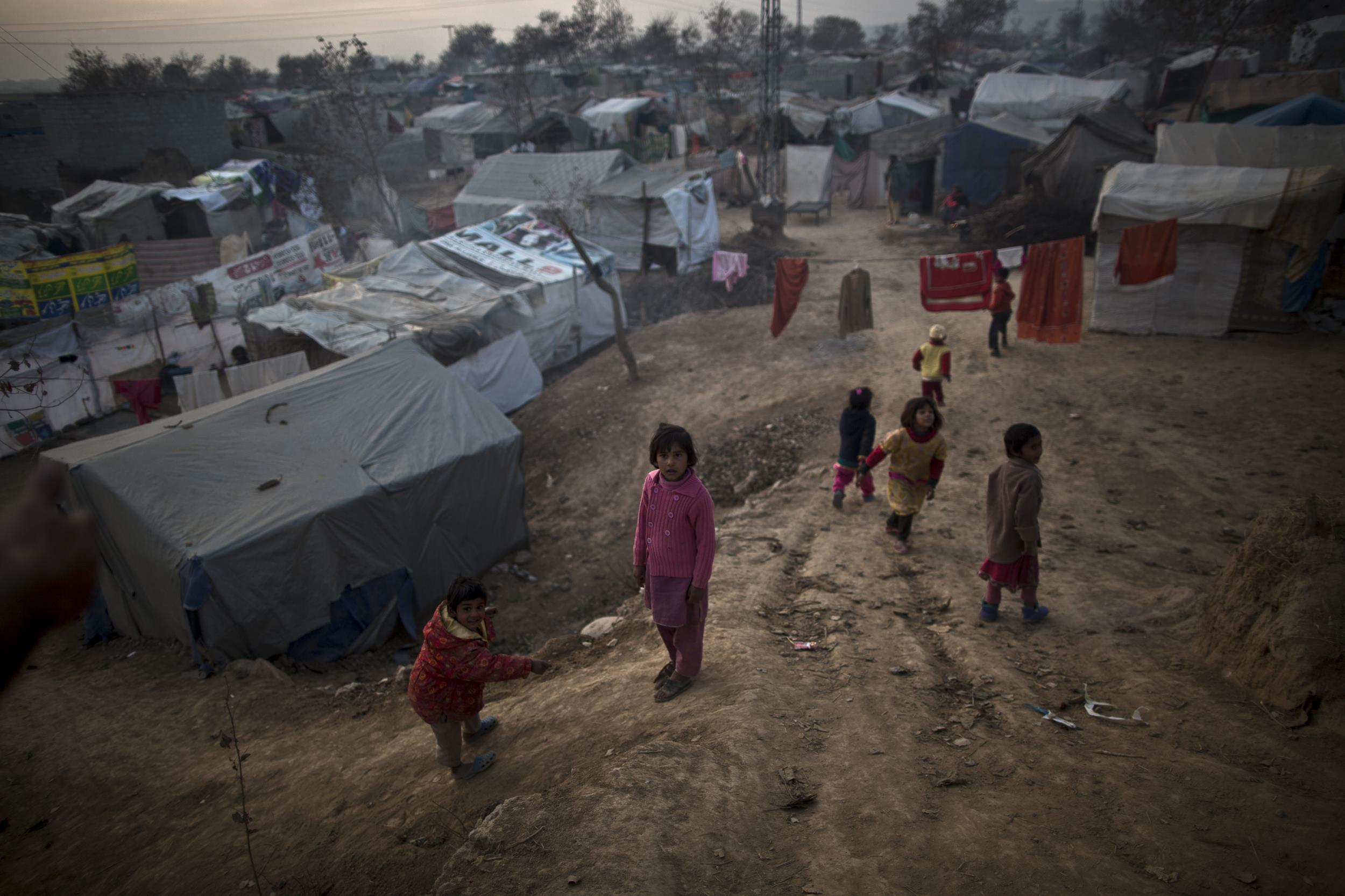 Pakistani Christian children play in a slum that hosts poor Christian families