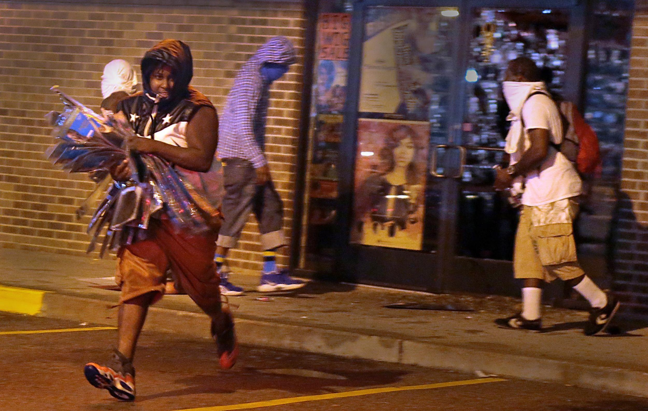 Image: Protesters defy police, take to the streets of Ferguson