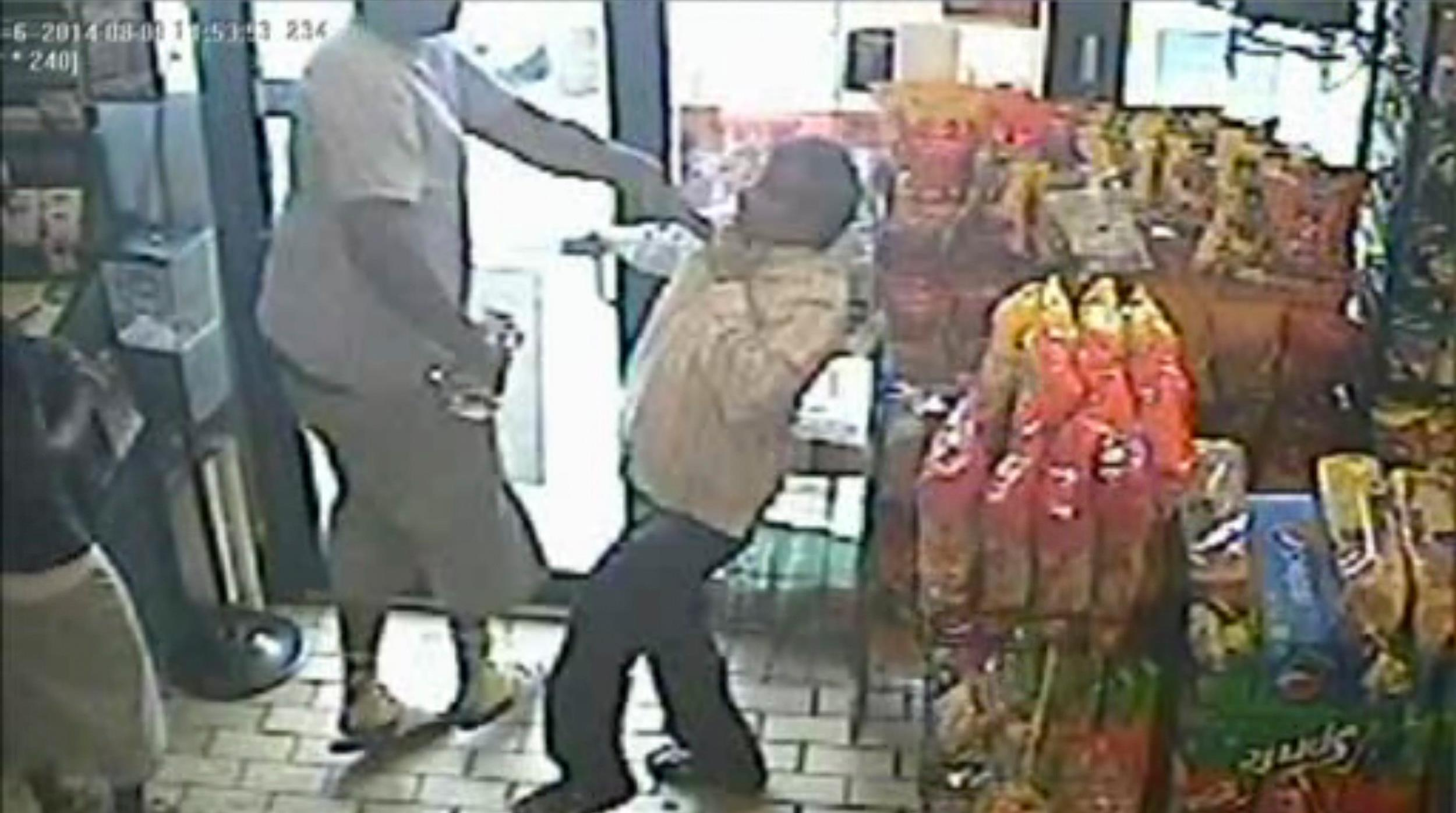 Image: An incident in a store in Ferguson, Missouri August 9, 2014 is seen in this still image taken from a security camera