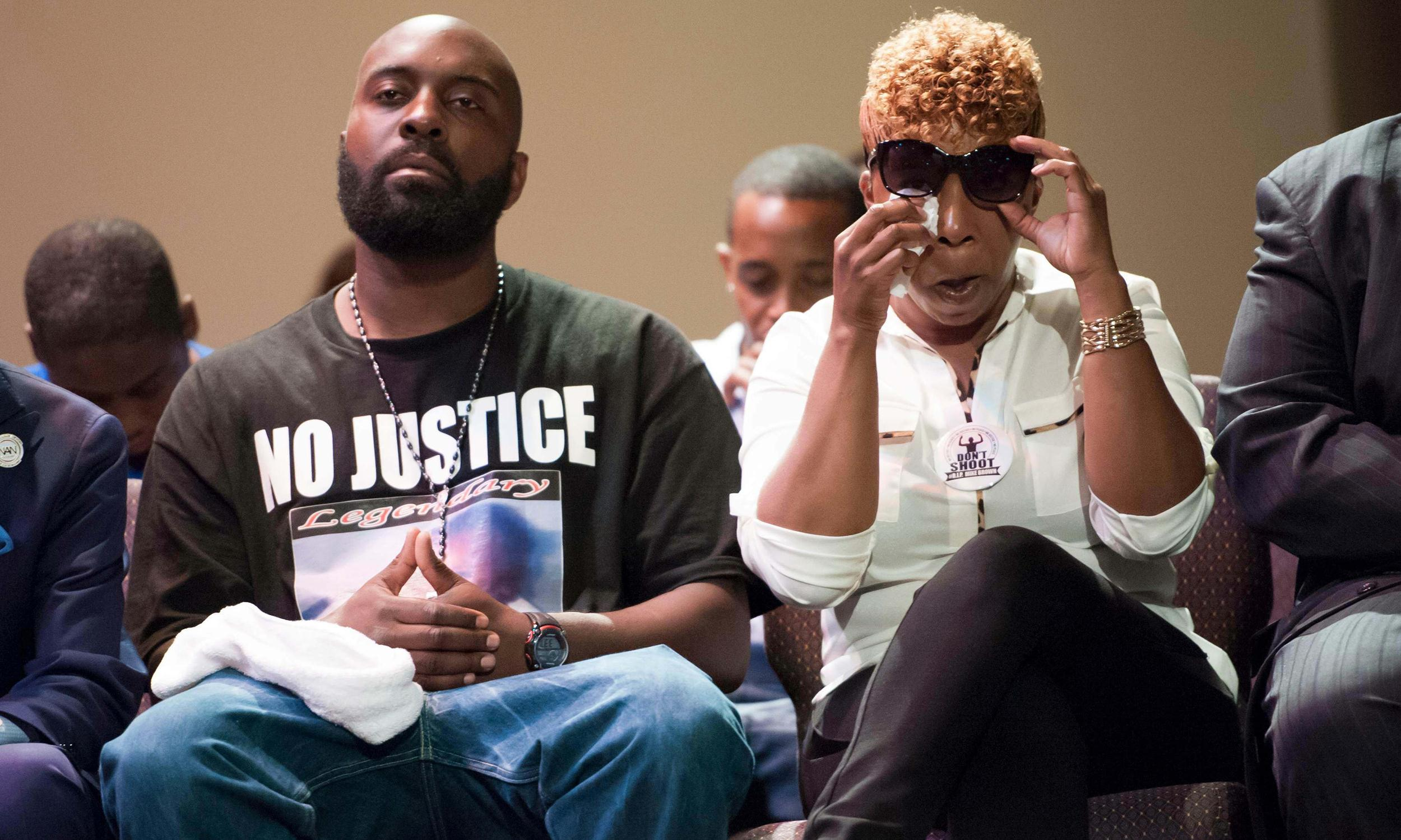 Image: Michael Brown's family listens during a rally convened in reaction to the shooting of their son, in Ferguson, Missouri