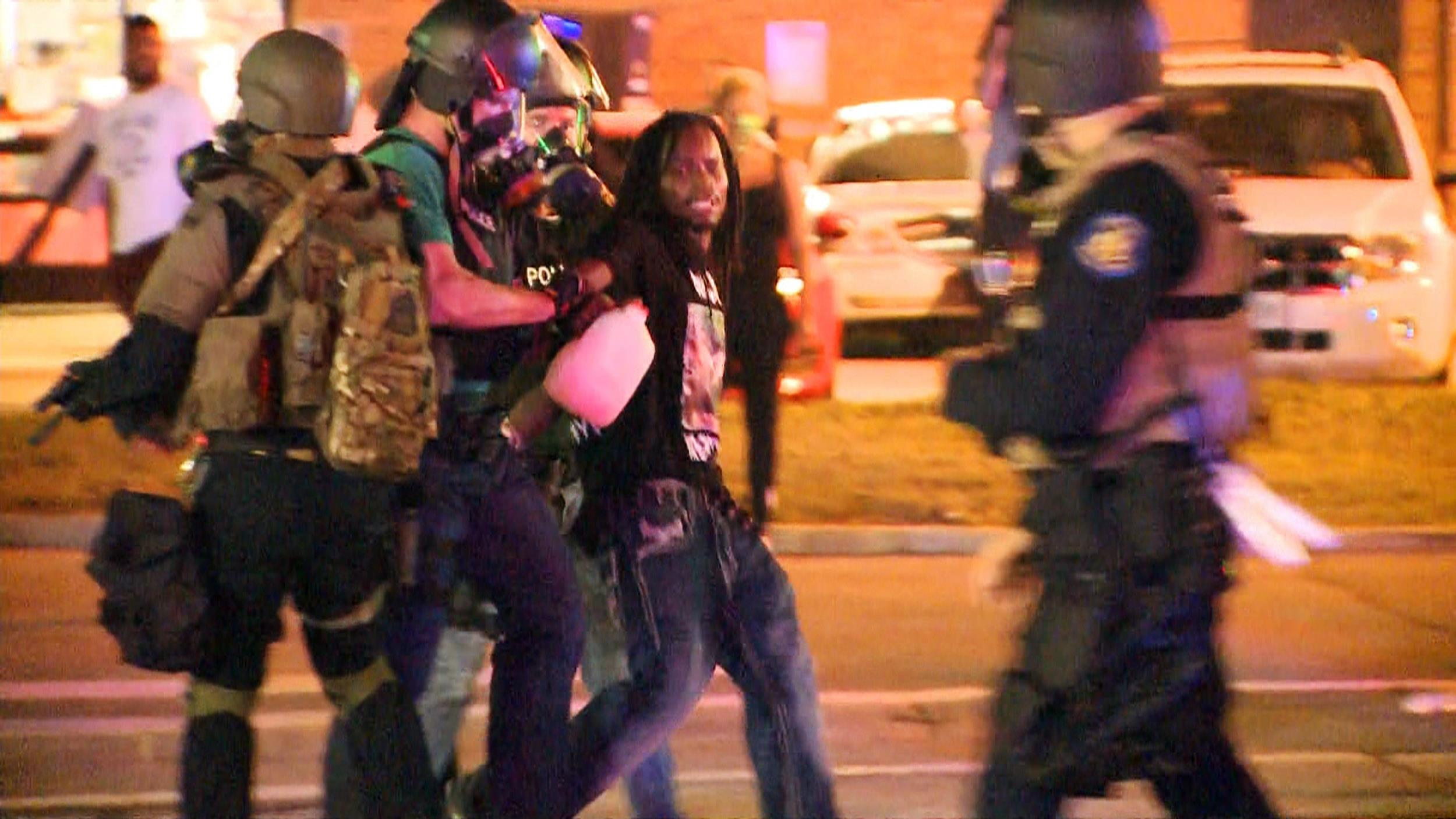 Image: Police arrest a man in Ferguson, Mo., on Aug. 18.
