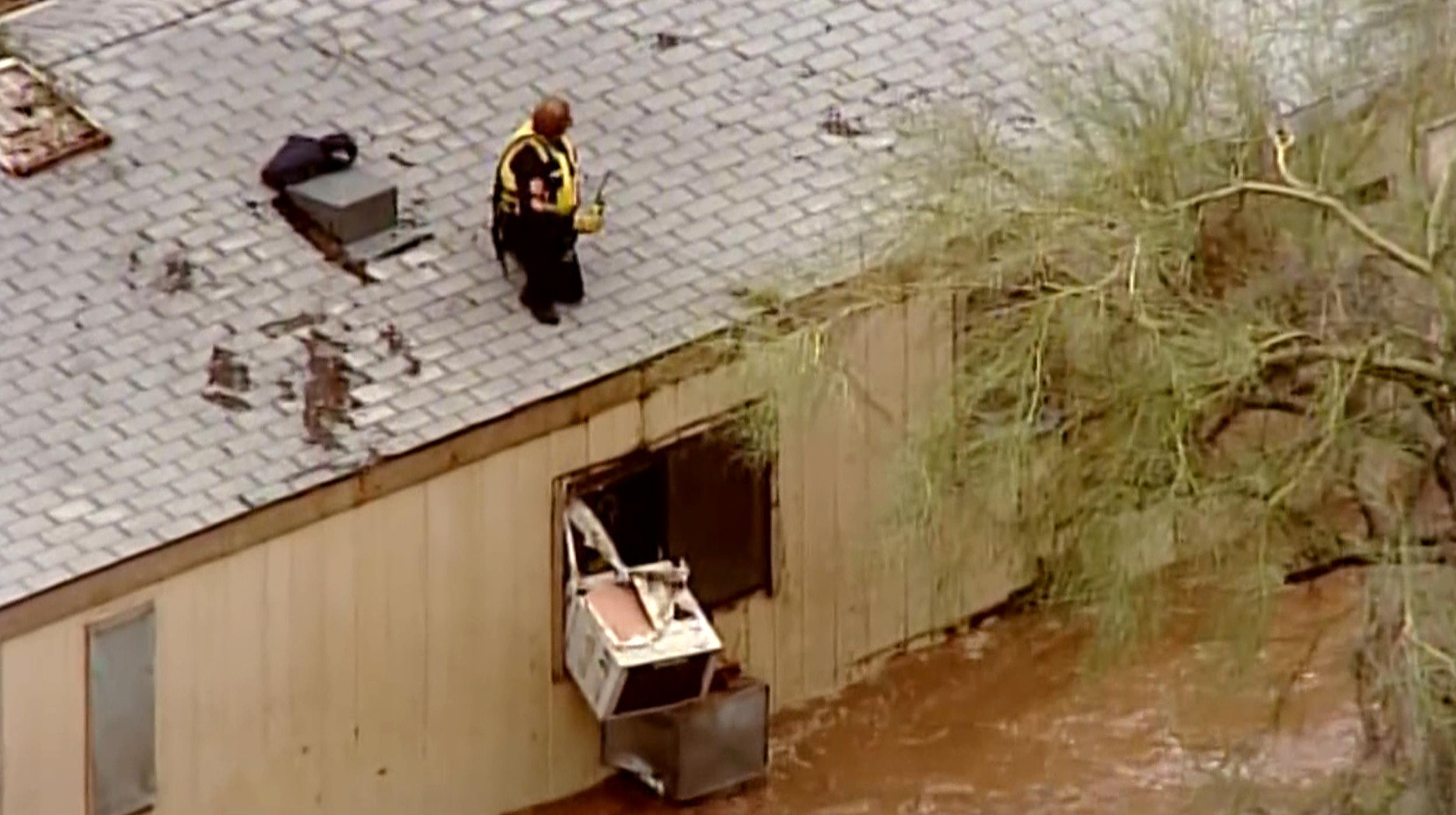 Image: First responders attempt to rescue people trapped by flooding in Arizona.