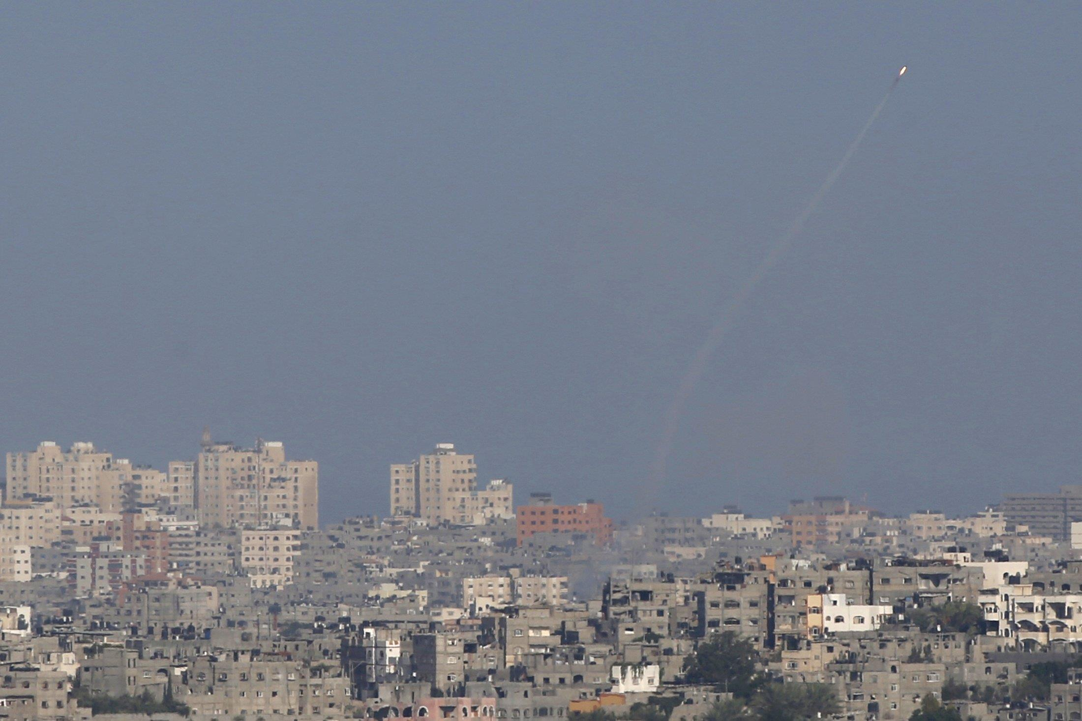 Image: A smoke trail is seen as a rocket is launched from the Gaza Strip towards Israel