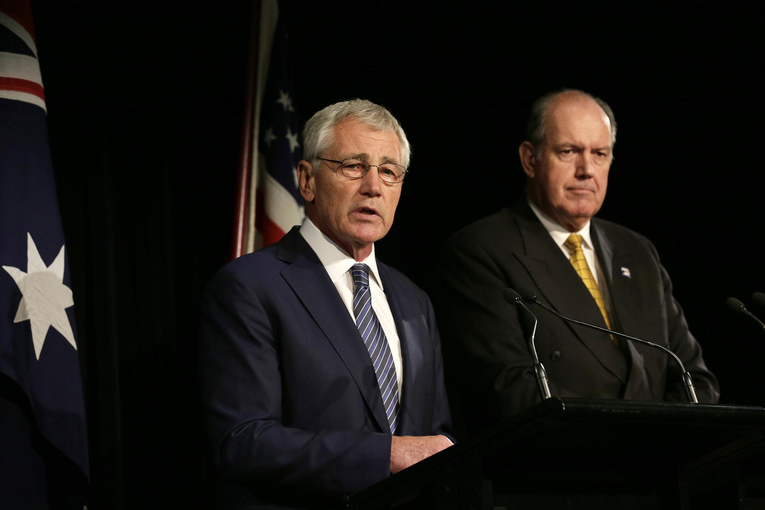 Image: US Secretary of Defense Chuck Hagel and Australia's Defence Minister David Johnston speaking during a joint press conference in Sydney, on Aug. 11 .