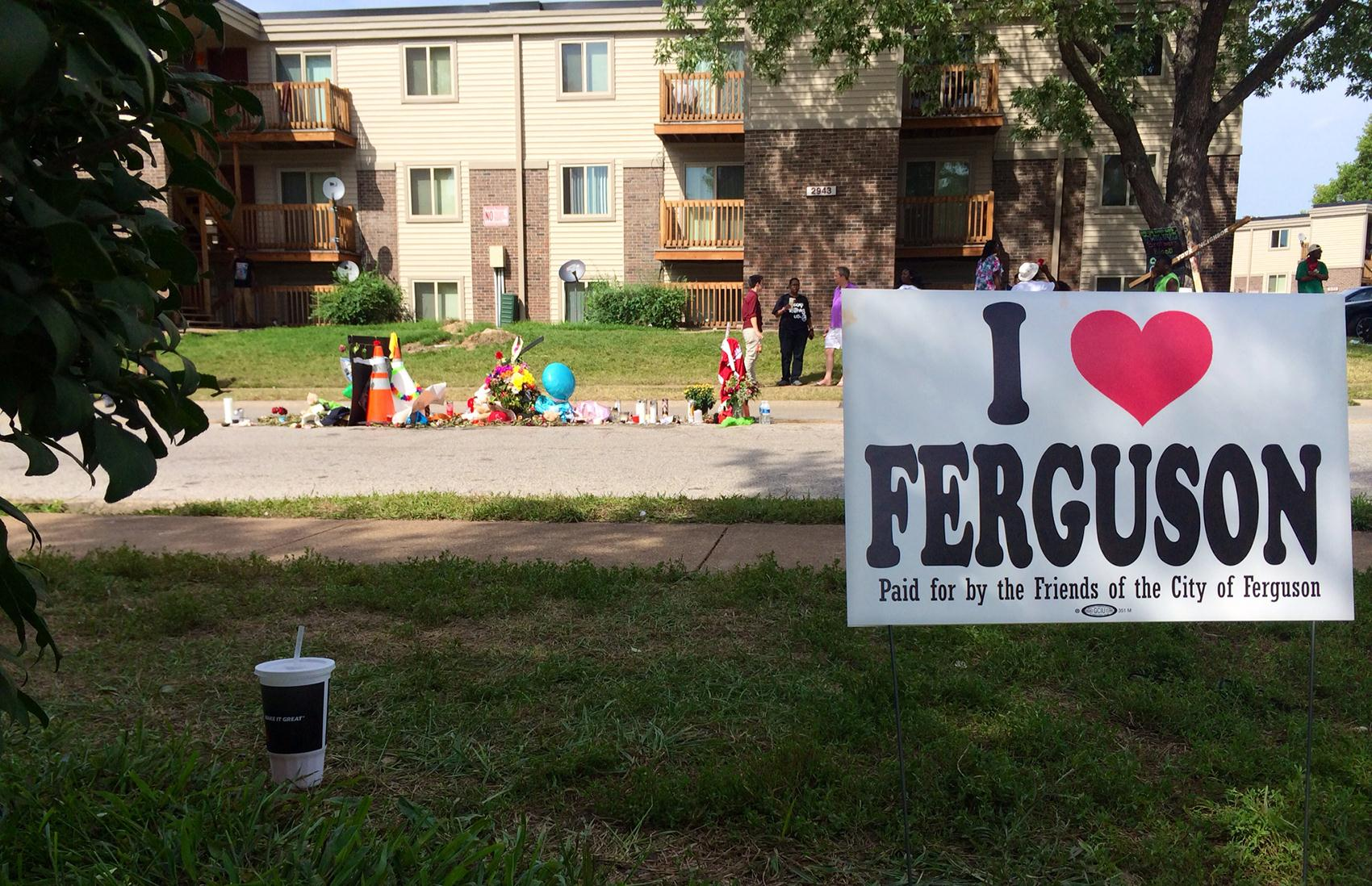 Image: A sign near the site of where Michael Brown died