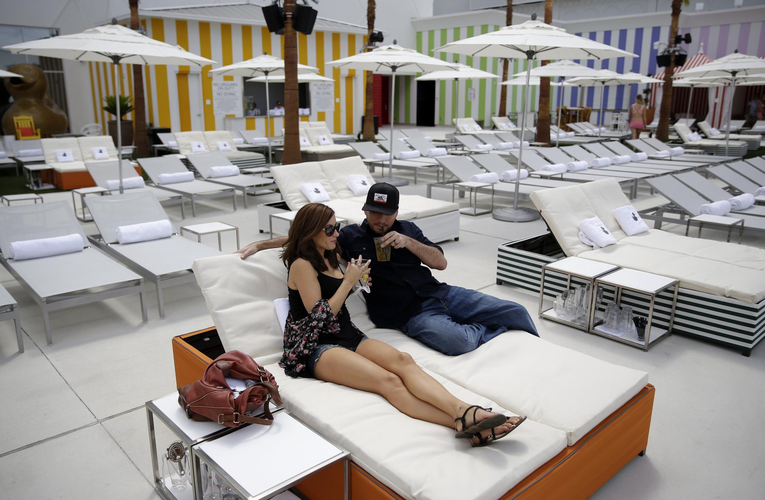 Image: Amelia Perez, left, and Fabian Perez lounge by the pool at the SLS Las Vegas in Las Vegas