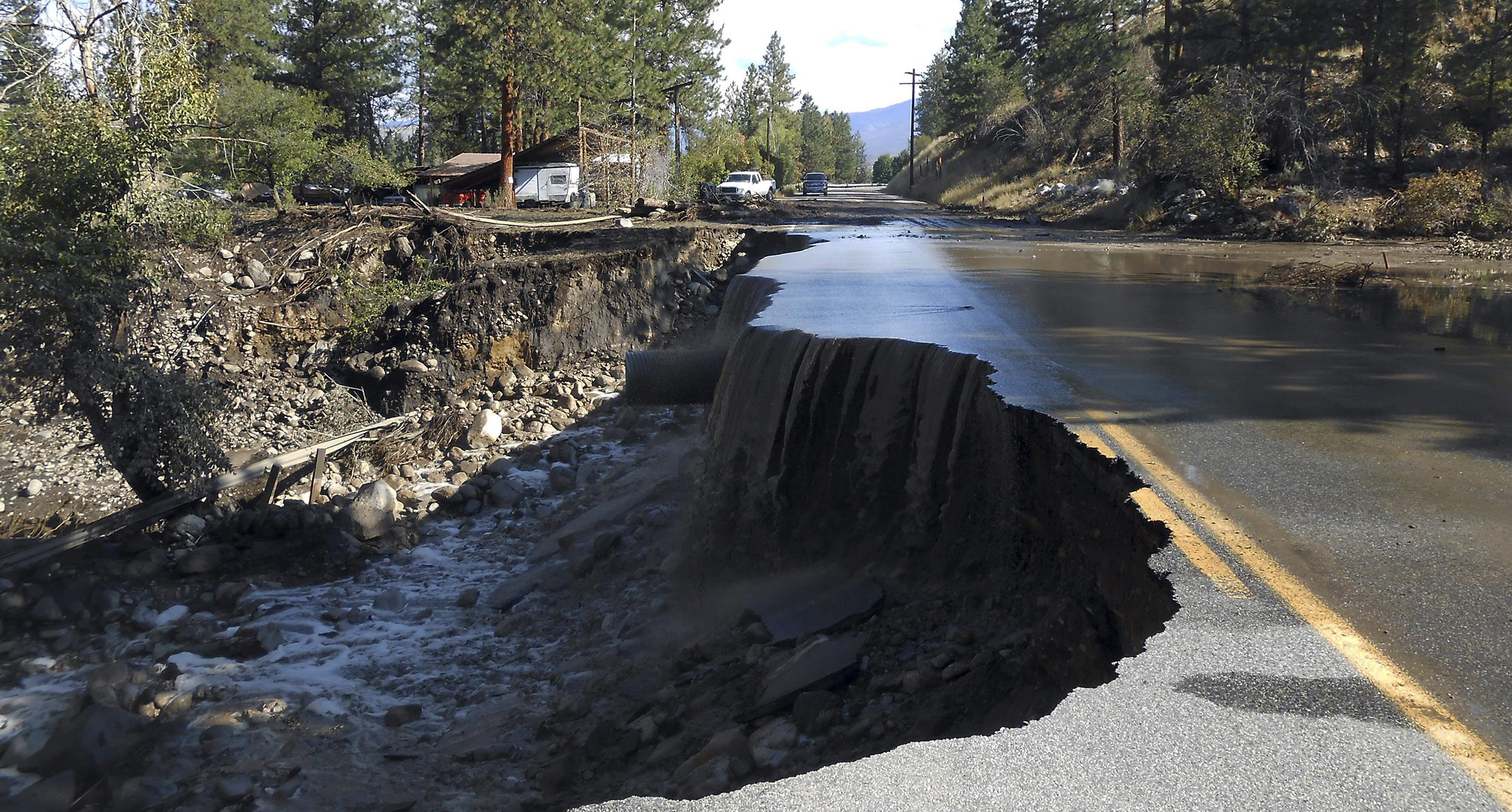 Image: Washington State Department of Transportation water pours over a damaged road east of Twisp, Wash