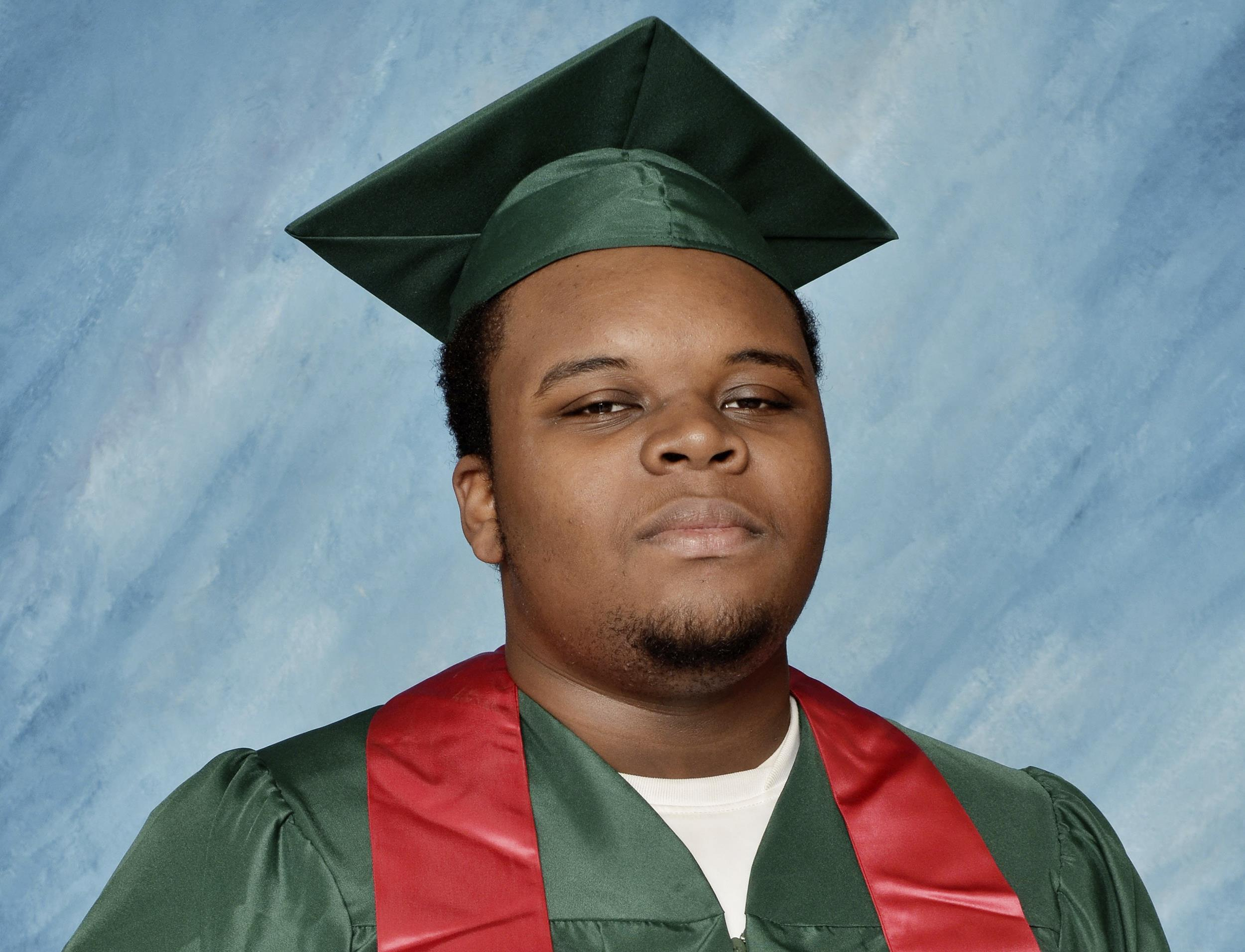 Image: Michael Brown poses for a photo in his cap and gown taken in March 2014