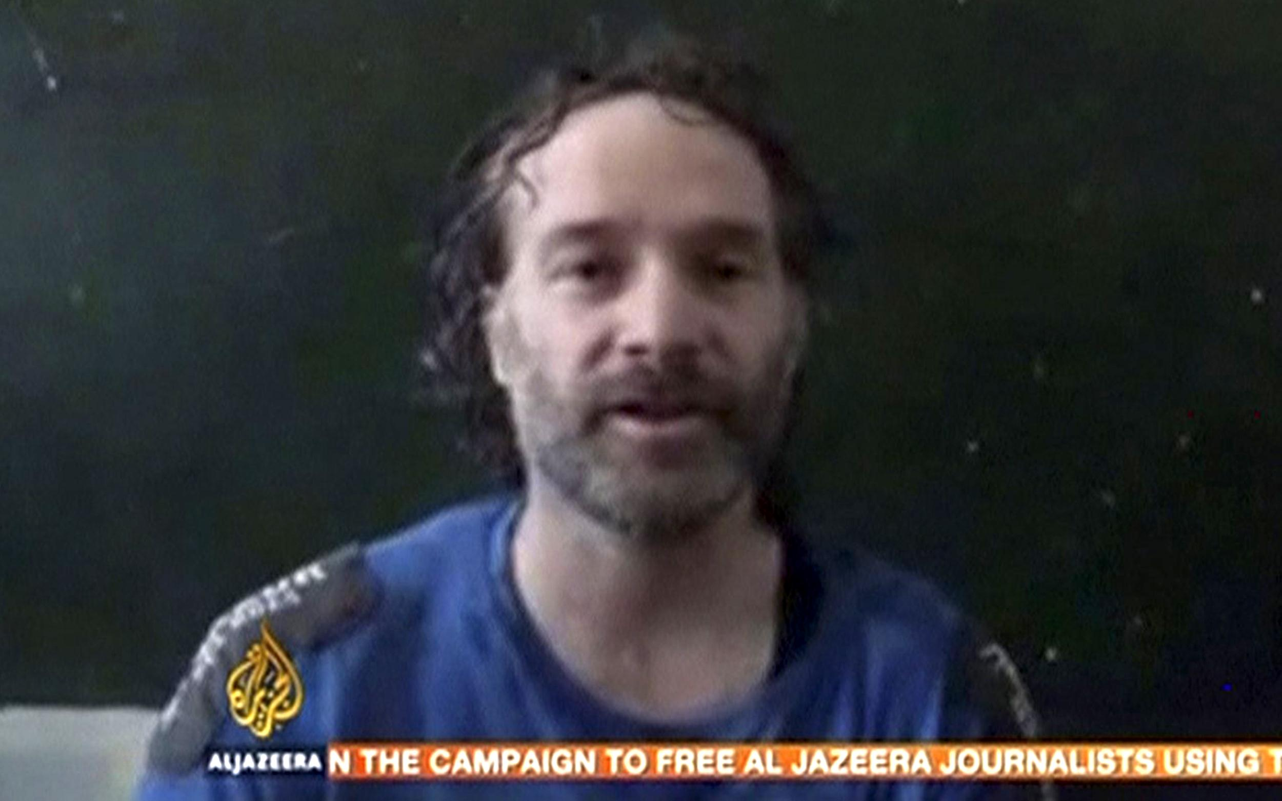 Image: Still frame taken from video shows U.S. journalist Peter Theo Curtis, who has been freed by kidnappers in Syria