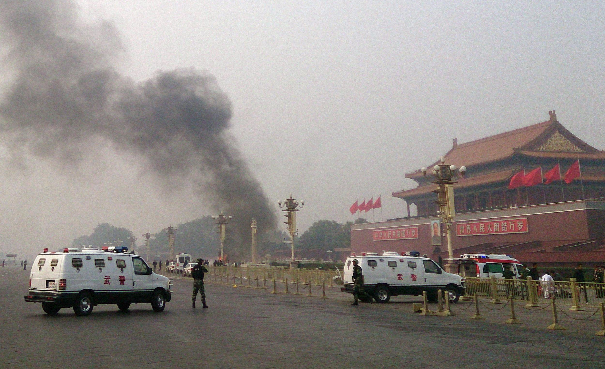 Image: Police cars blocking off the roads leading into Tiananmen Square