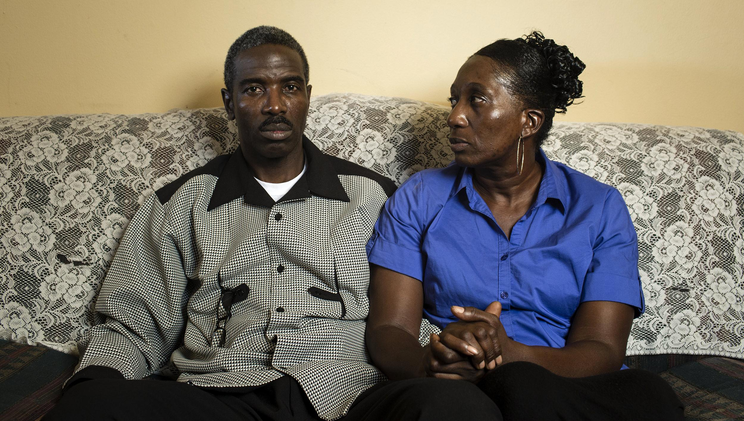 Image: Rev. Victor White and Vanessa White, parents of the deceased Victor White III photographed in their living room in Alexandria.