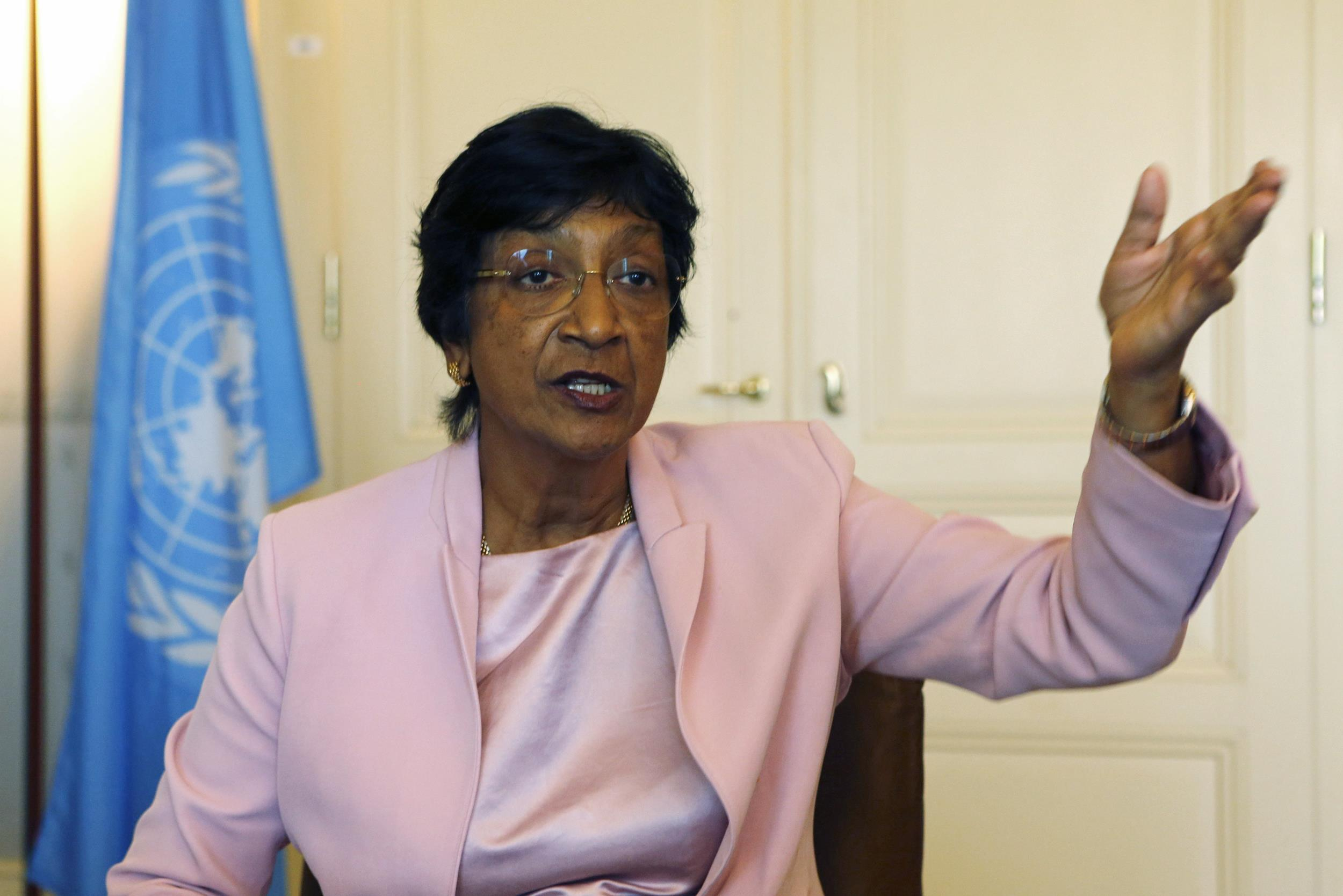 Image: Outgoing U.N. Human Rights Commissioner Navi Pillay talks during an interview to Reuters in her office in Geneva
