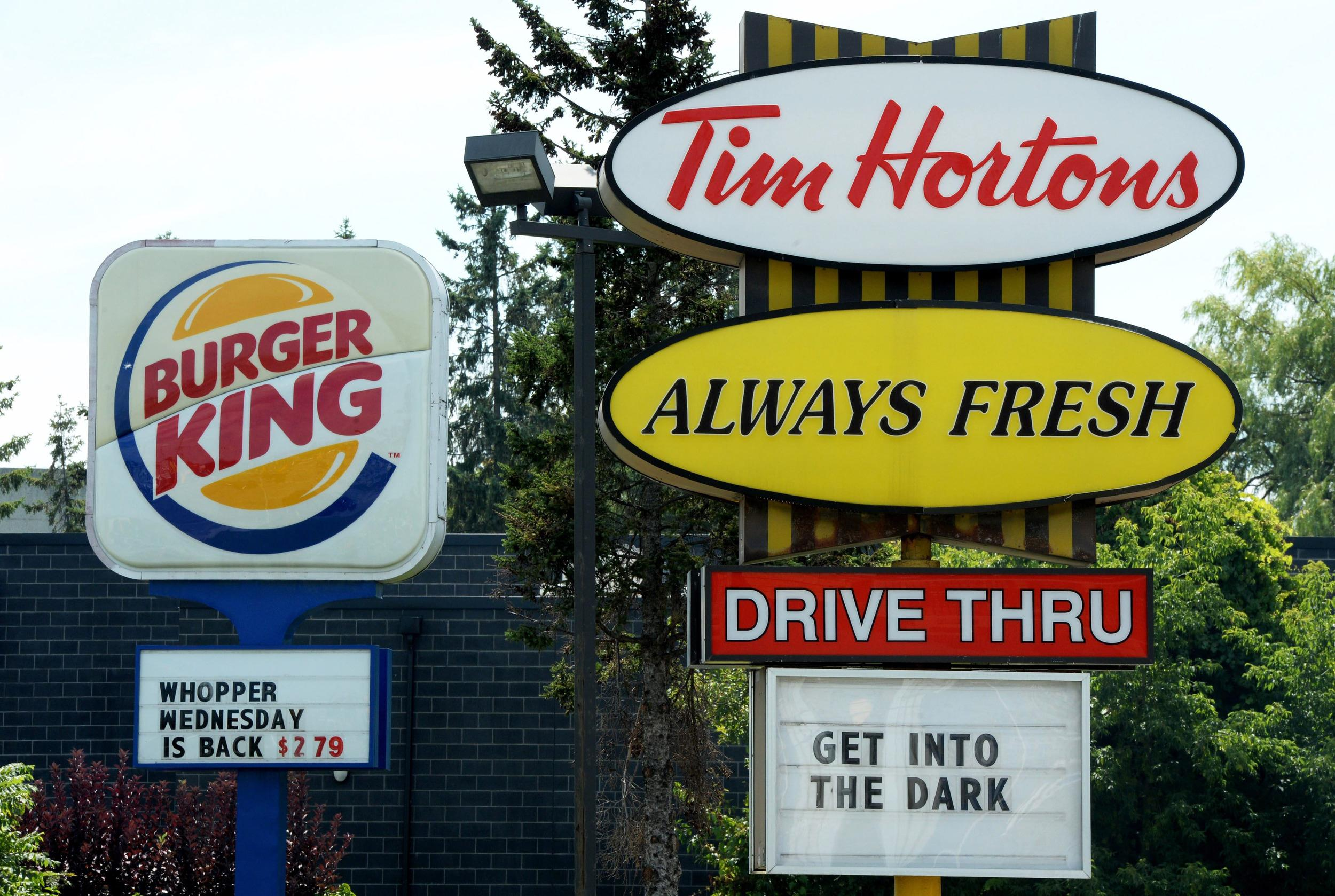Burger King confirmed it reached a deal to buy Canada's Tim Hortons chain for about $11 billion.