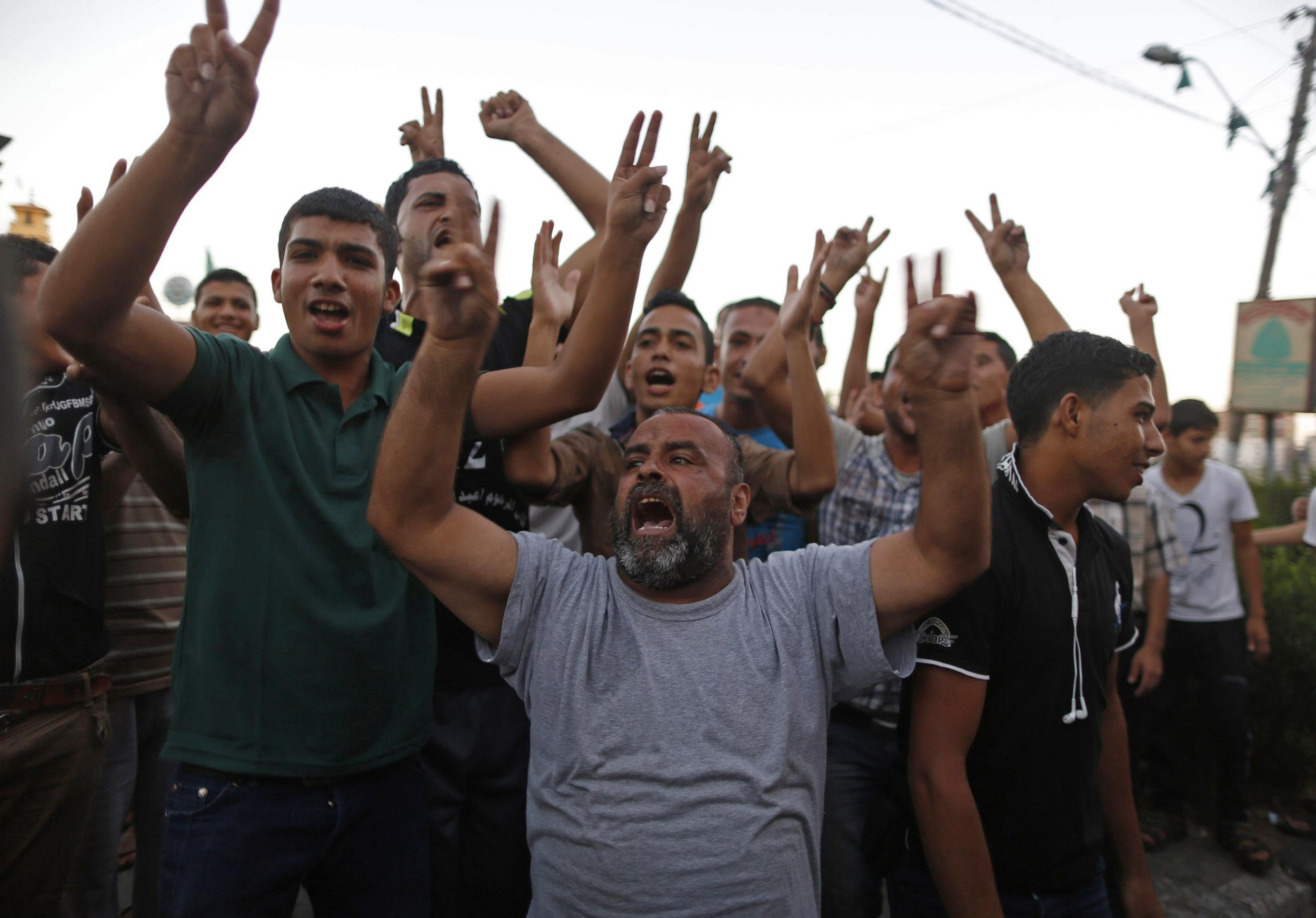 Image: Palestinians celebrate what they said was a victory over Israel following a ceasefire, in Gaza City
