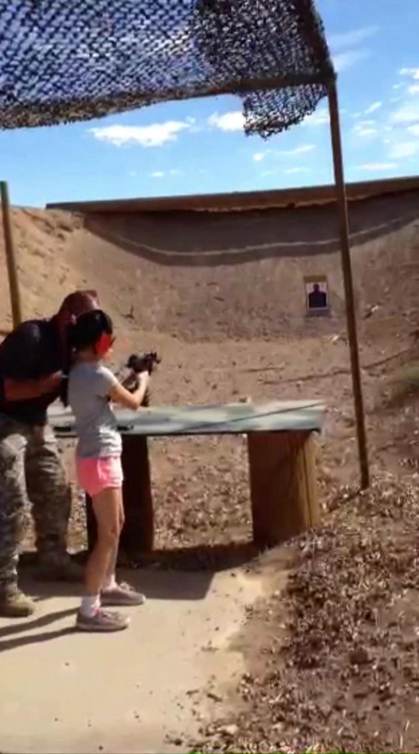 Image: Charles Vacca, 39, teaches a 9-year-old girl how to shoot an Uzi moments before he was shot