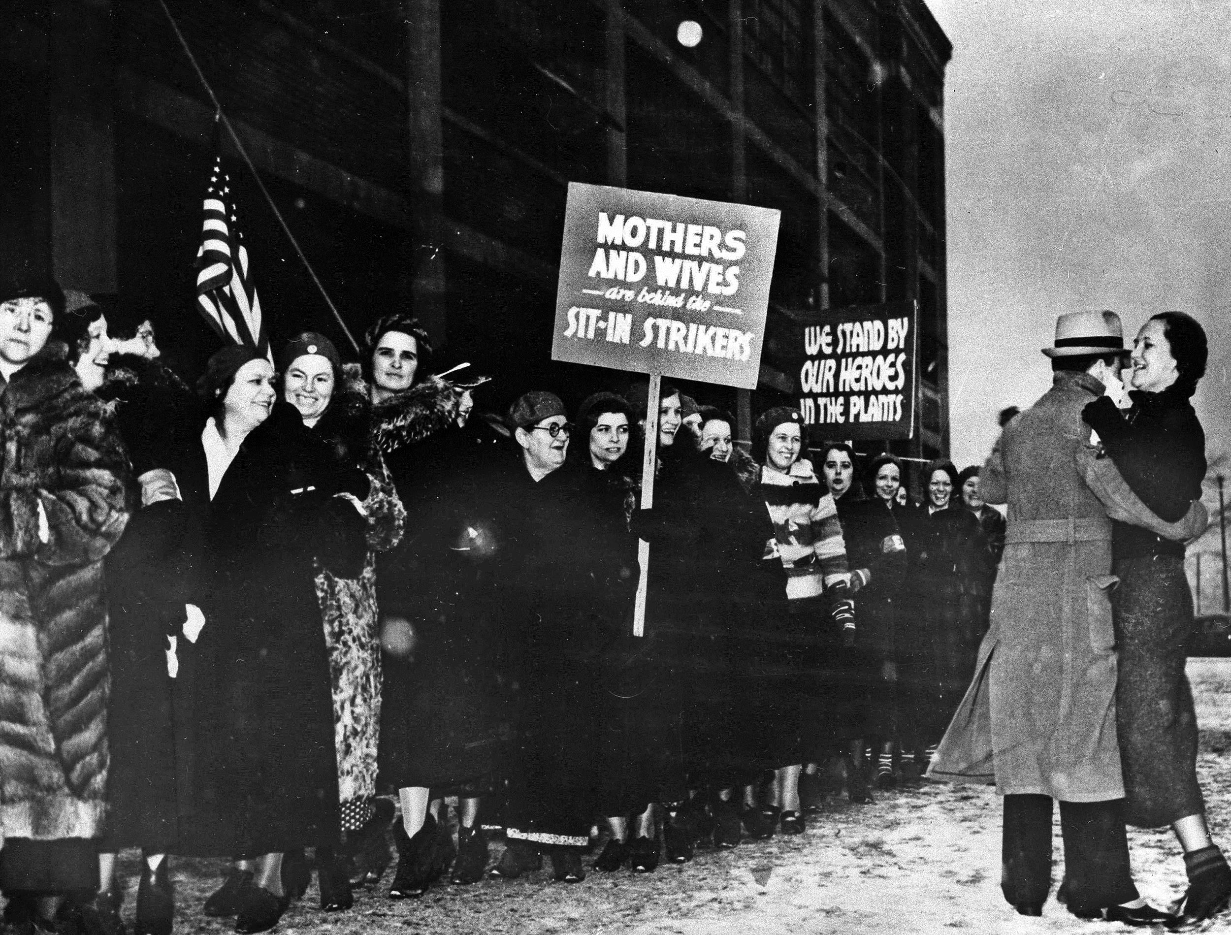 Image: Wives, sisters and sweethearts of strikers demonstrate at plant in Flint, Mich.,