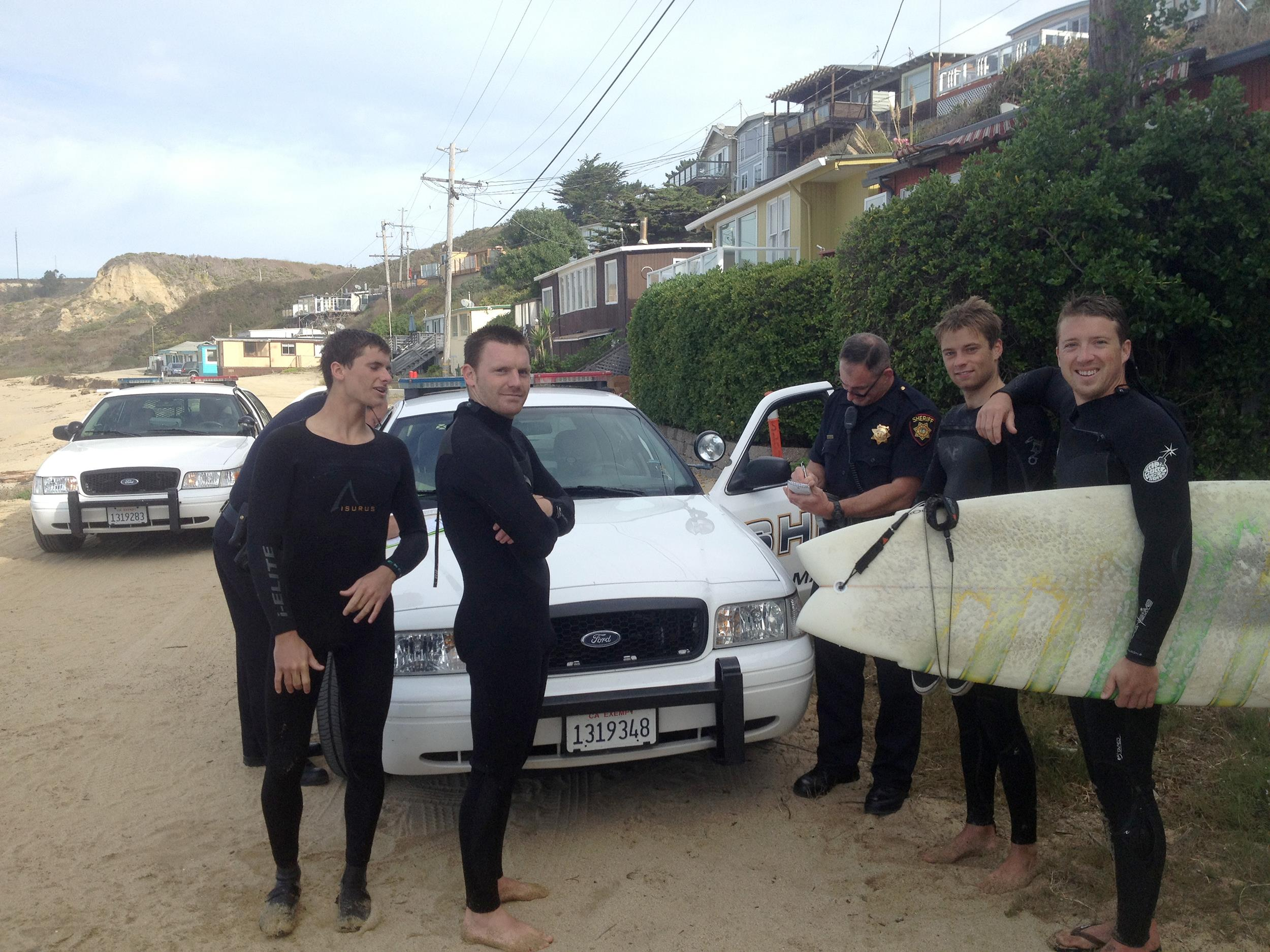 Image: Surfers are arrested during a dispute over beach access