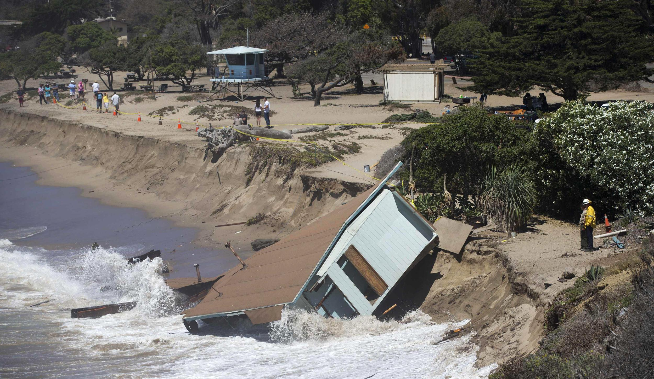 Image: The Cove House Lifeguard Administrative Building is pictured after it was destroyed by waves in Point Mugu