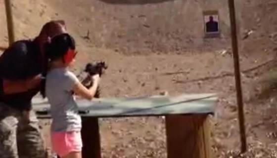 Instructor Charles Vacca instructing a young girl on firing an Uzi moments before he was killed