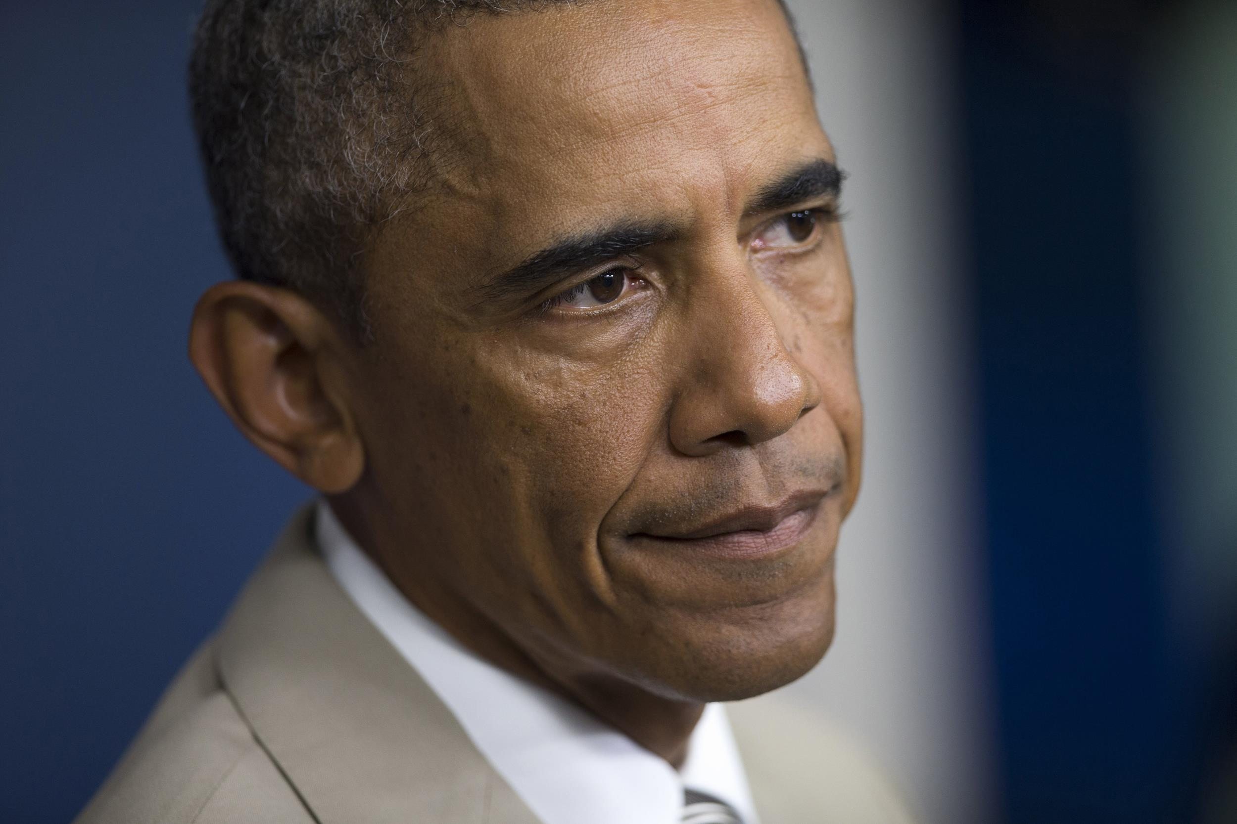 Image: President Barack Obama listens to a question in the James Brady Press Briefing Room